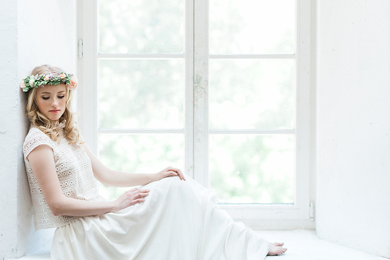 Lithuanian bride with floral crown and 2 piece lace dress - photo by Jurgita Lukos