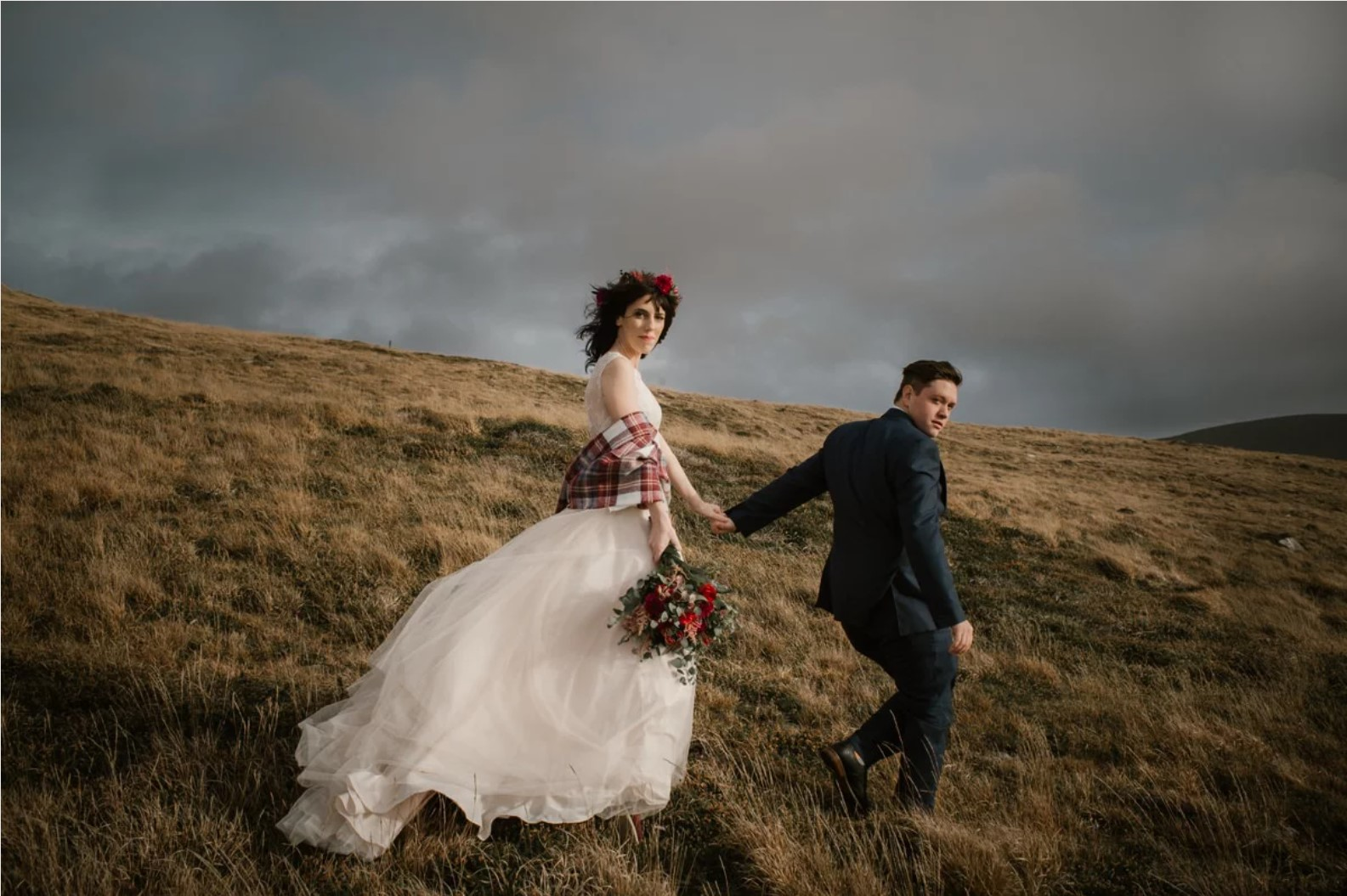 Elopement photo in open field in Ireland by White Cat Studio