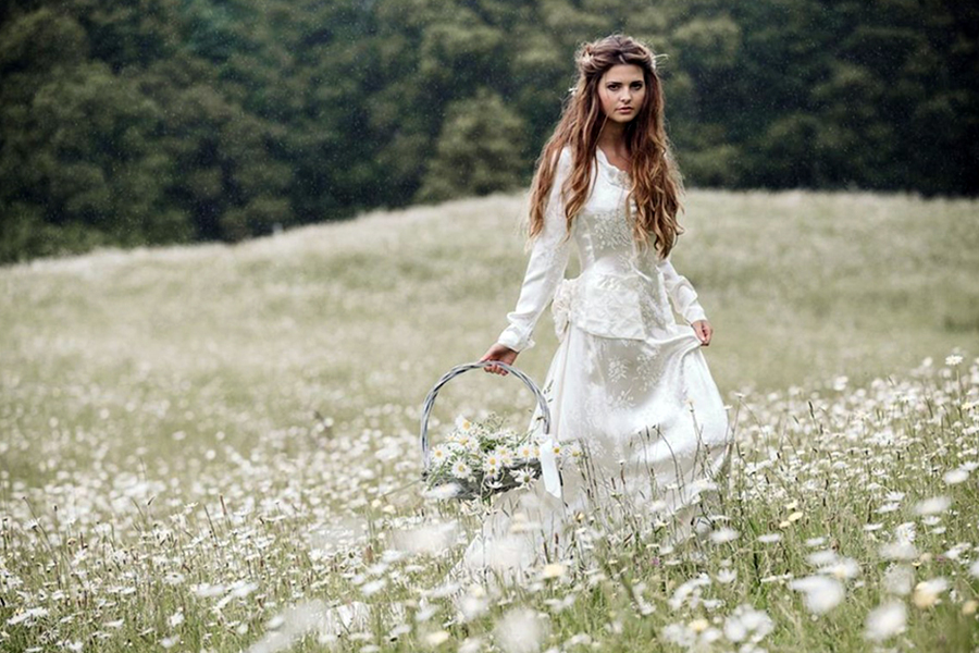 Photo of bride in flower field by Two Little Starfish - New Zealand