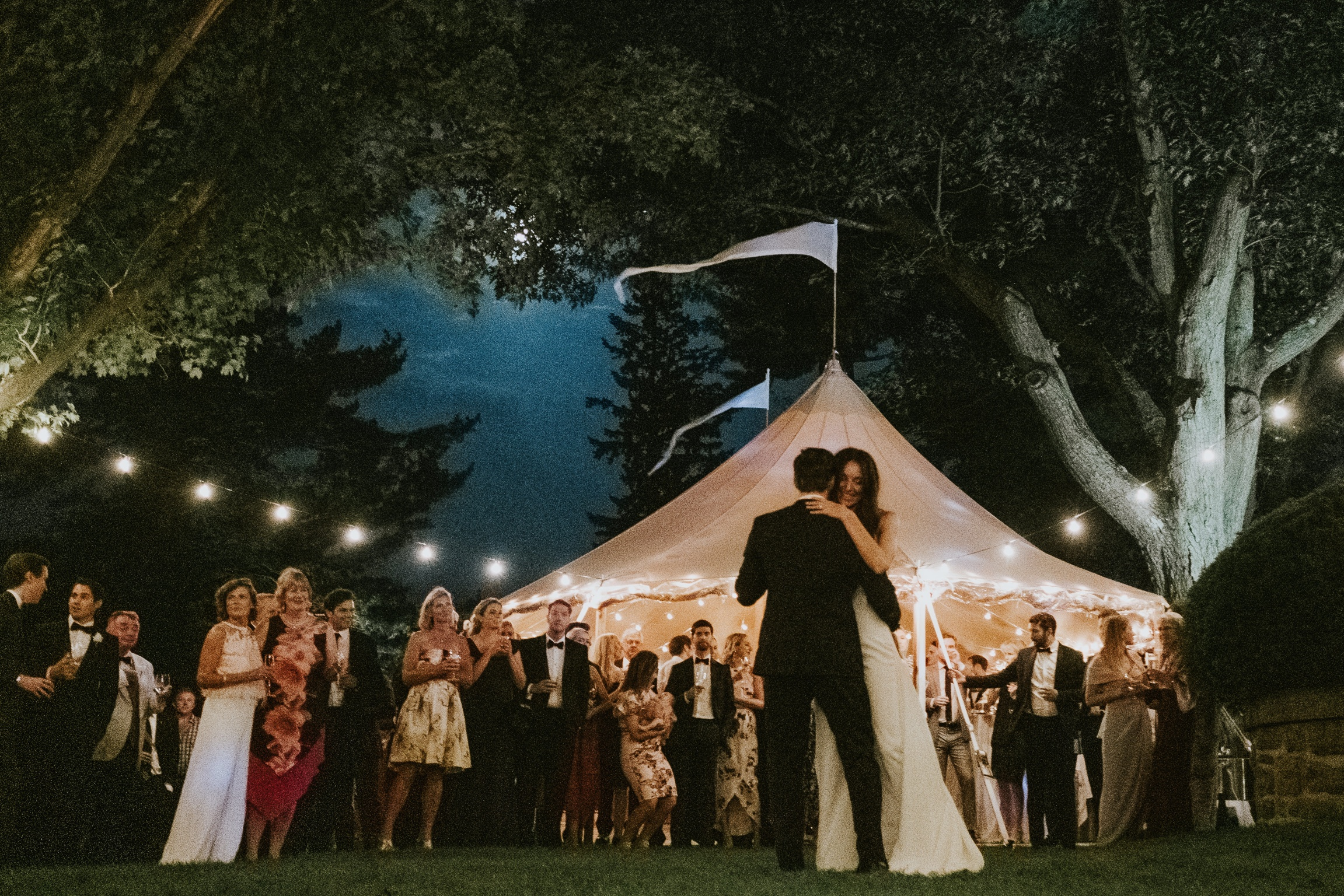 First dance at outdoor tented wedding reception photographed by Joel & Justyna - Ottawa wedding photographers