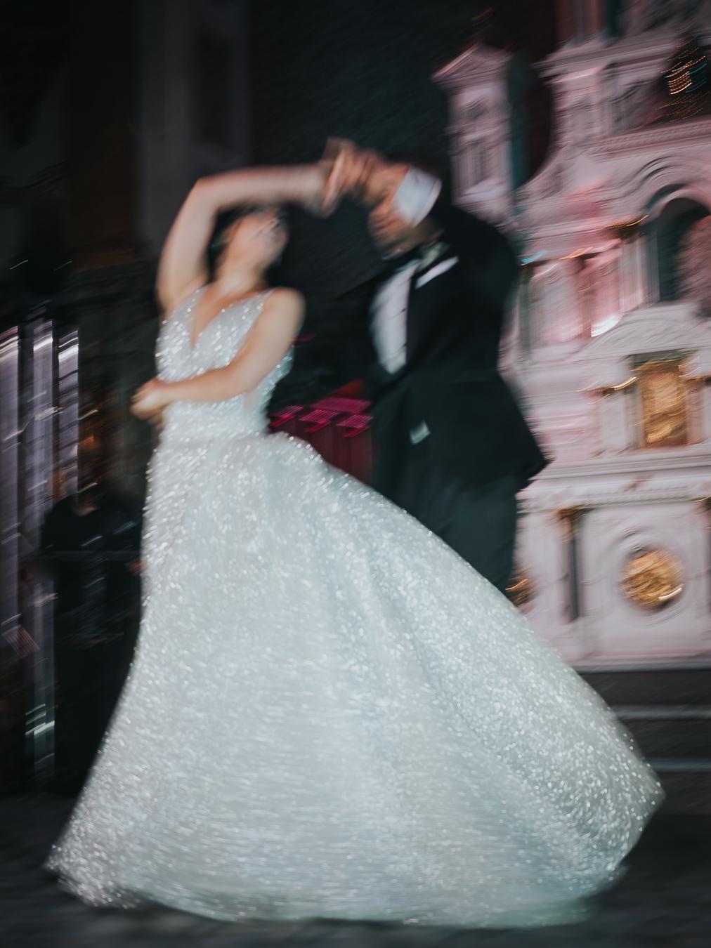 Slow shutter photo of couple twirling on dance floor by Joel & Justyna - Ottawa wedding photographers