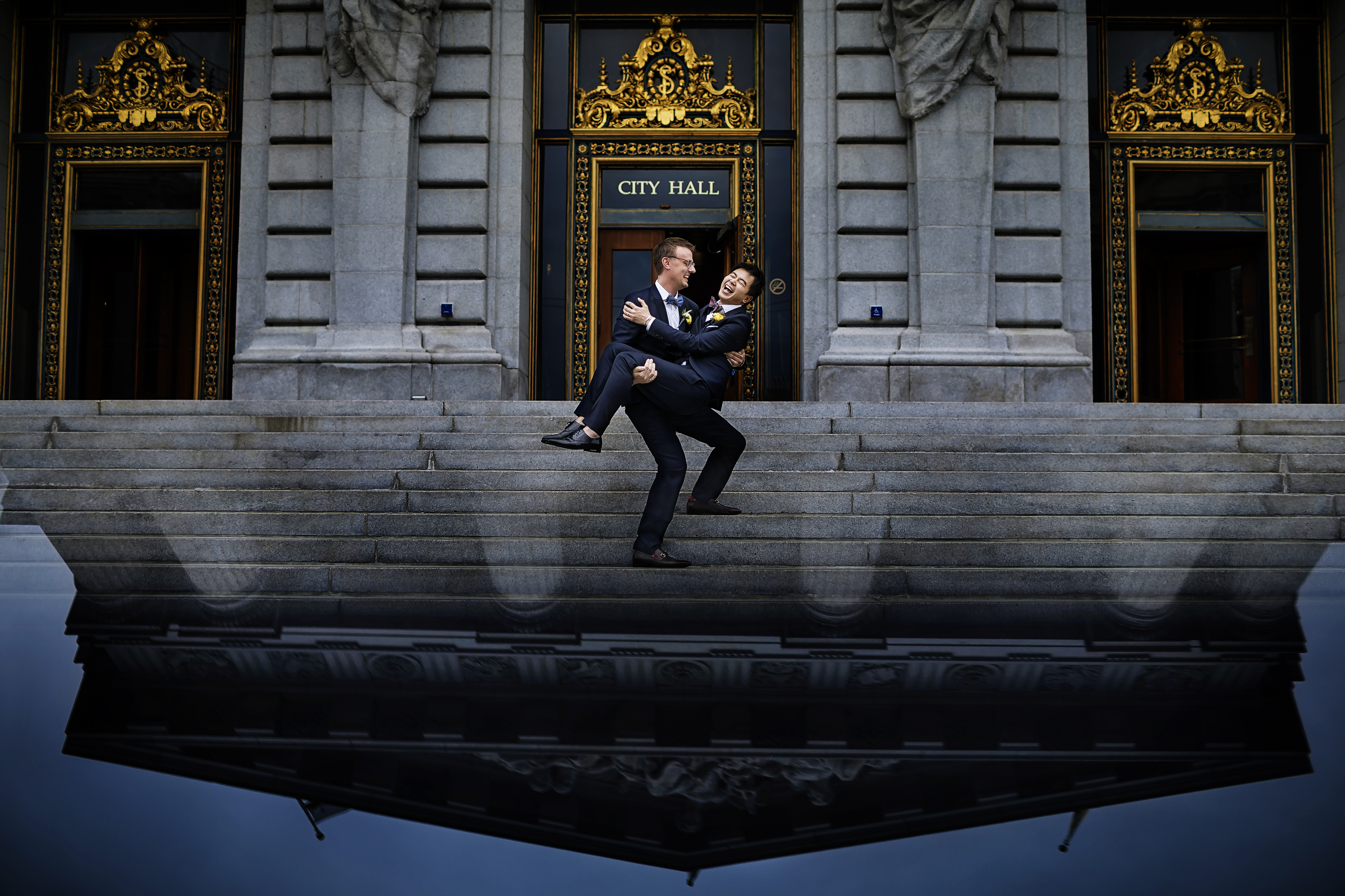 Just married grooms leaving the world famous San Francisco City Hall - photo by  Chrisman Studios