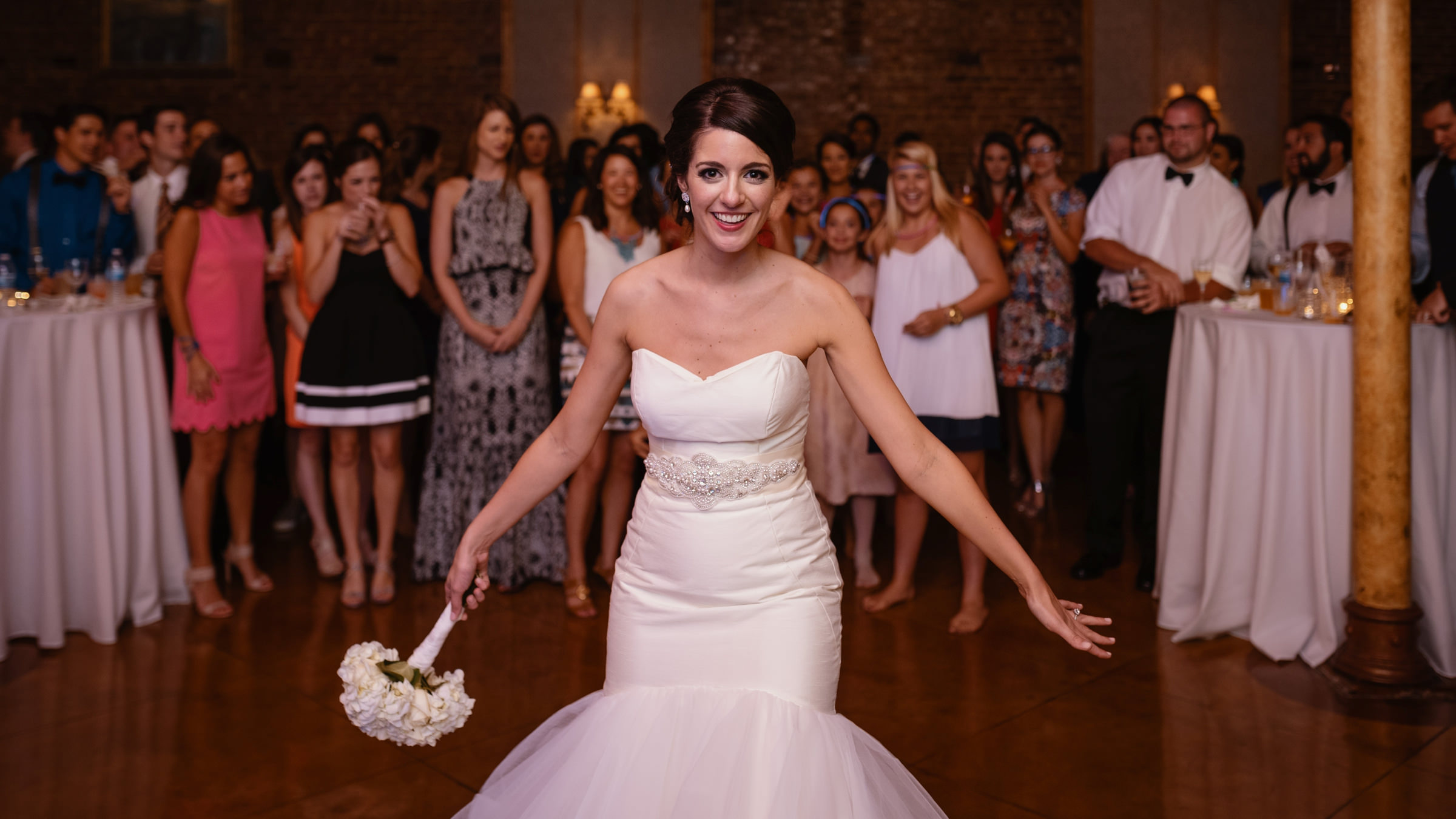 Bride gets ready to throw her bouqet to guests - Photo by Dark Roux - Texas wedding photographers