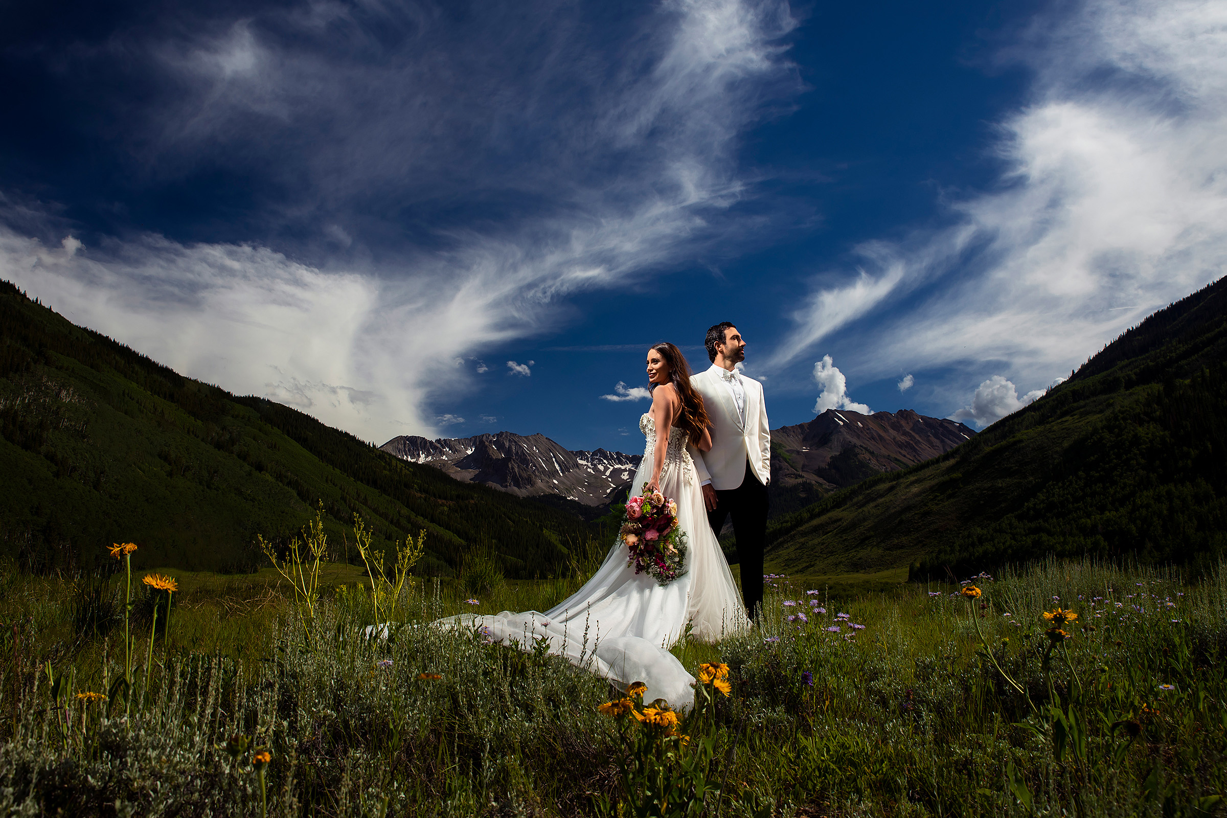 couple-in-wildflower-field-at-pine-creek-cookhouse-j-la-plante-photo