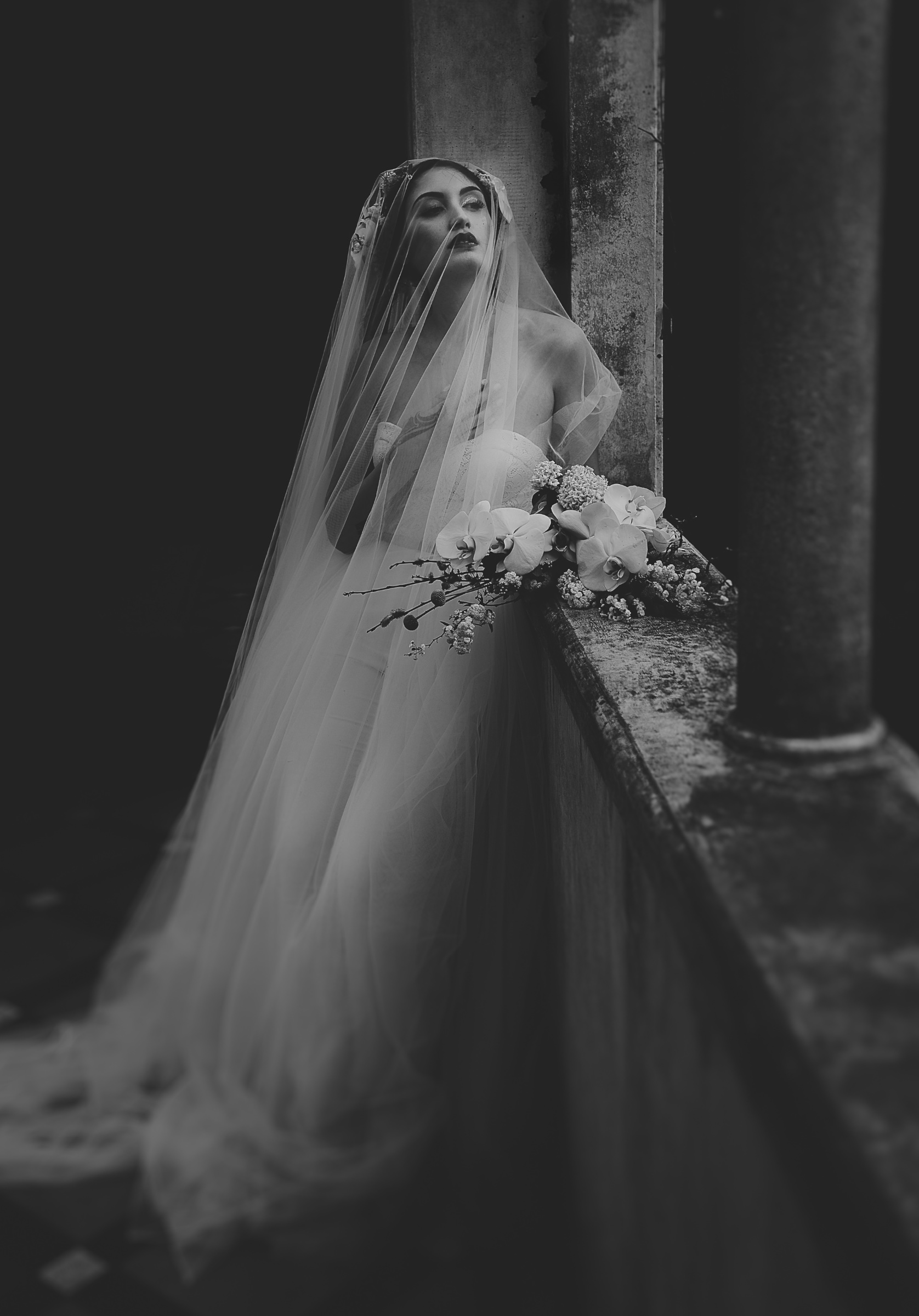 ethereal-black-and-white-photo-of-bride-with-long-veil-two-little-starfish-new-zealand