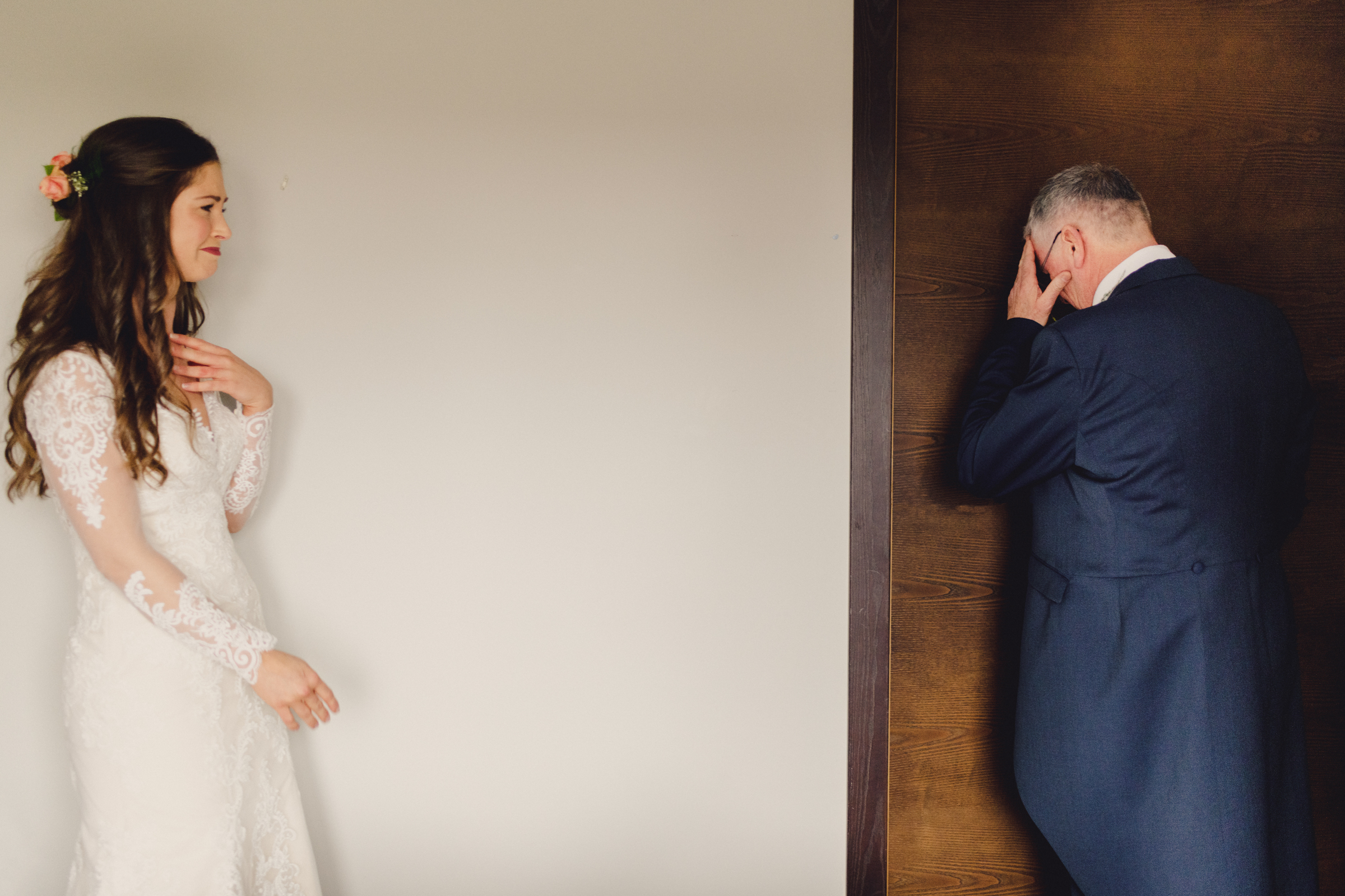 father-takes-a-moment-after-viewing-the-bride-miki-studios