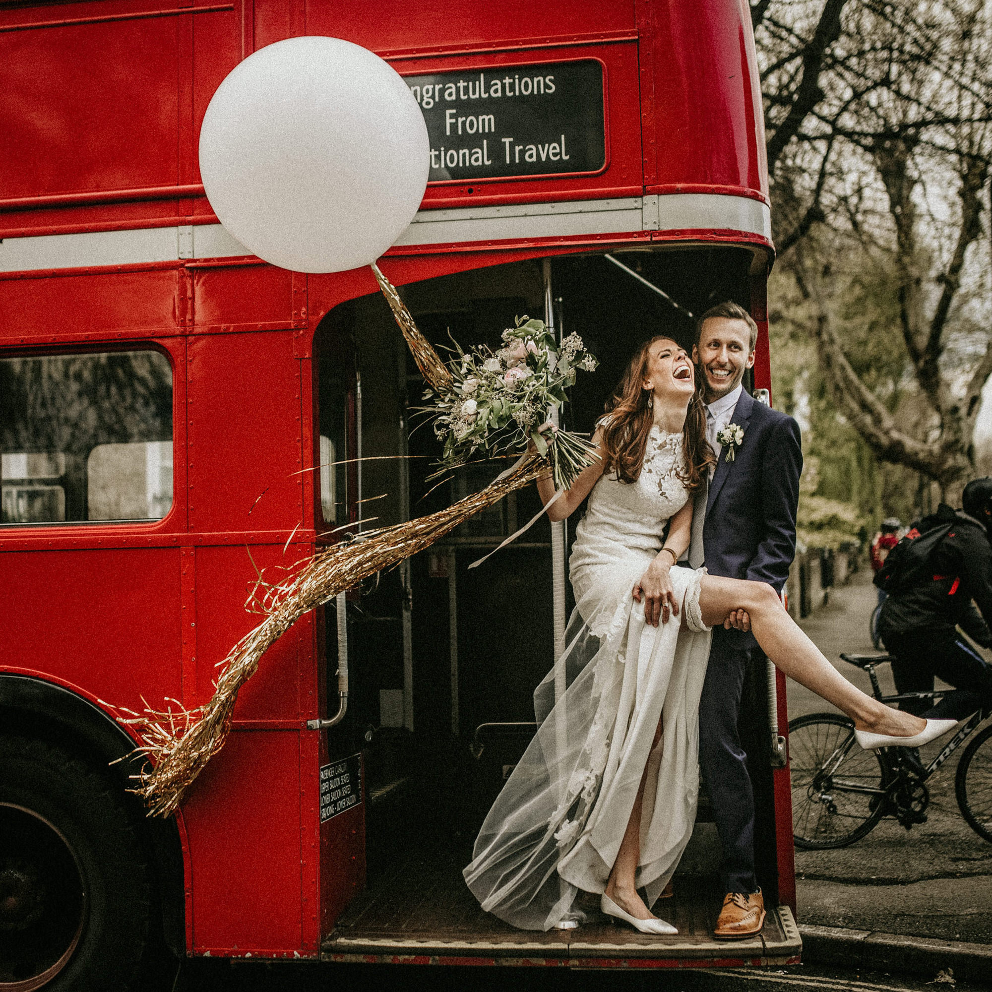 fun-couple-portrait-in-front-of-double-decker-red-bus-by-miki-studios