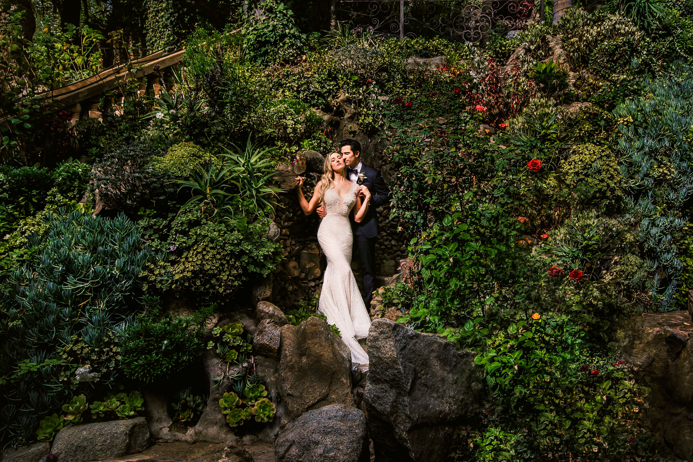 Portrait of couple at Houdini Mansion hedges by Marlies Hartmann of Los Angeles