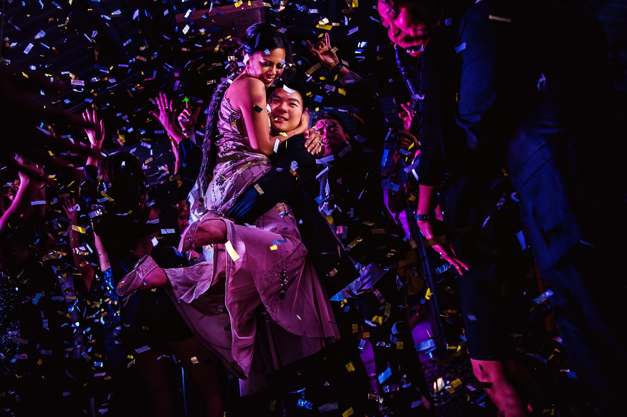 groom-picks-bride-up-during-confetti-explosion-wedding-dance-party-worlds-best-wedding-photos-davina-plus-daniel-canada-wedding-photographers