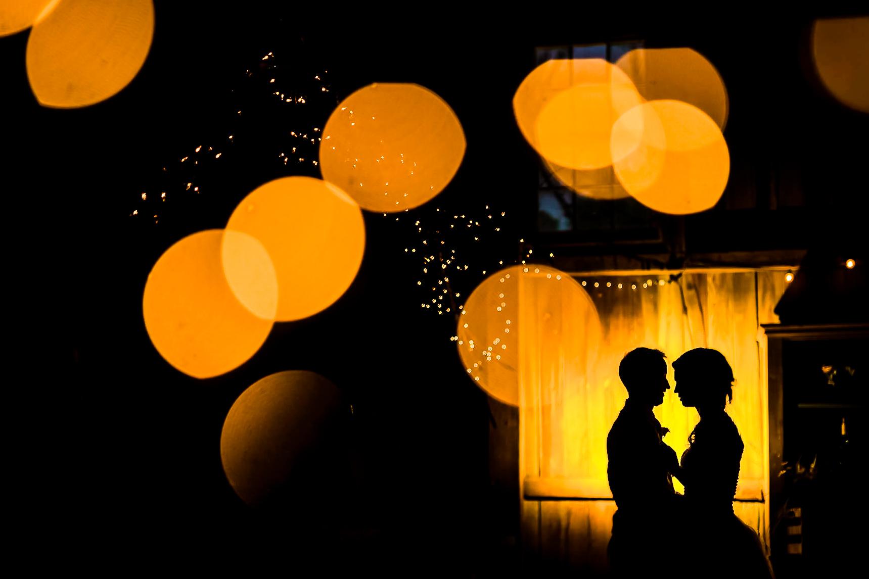 bokeh-silhouette-of-couple-under-golden-lights-smj-photography-pennsylvania