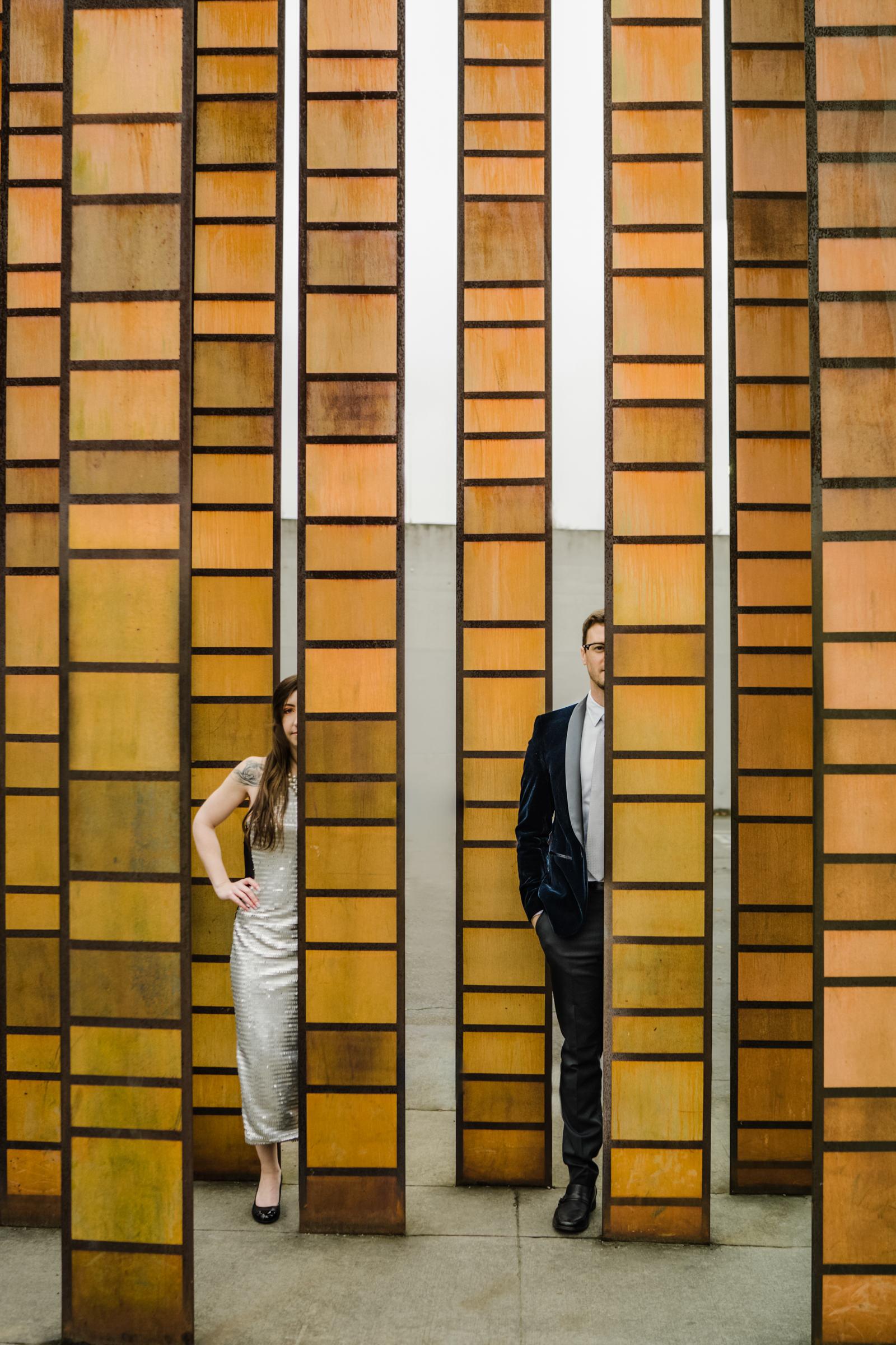 creative-portrait-of-couple-behind-art-sasha-reiko-photography