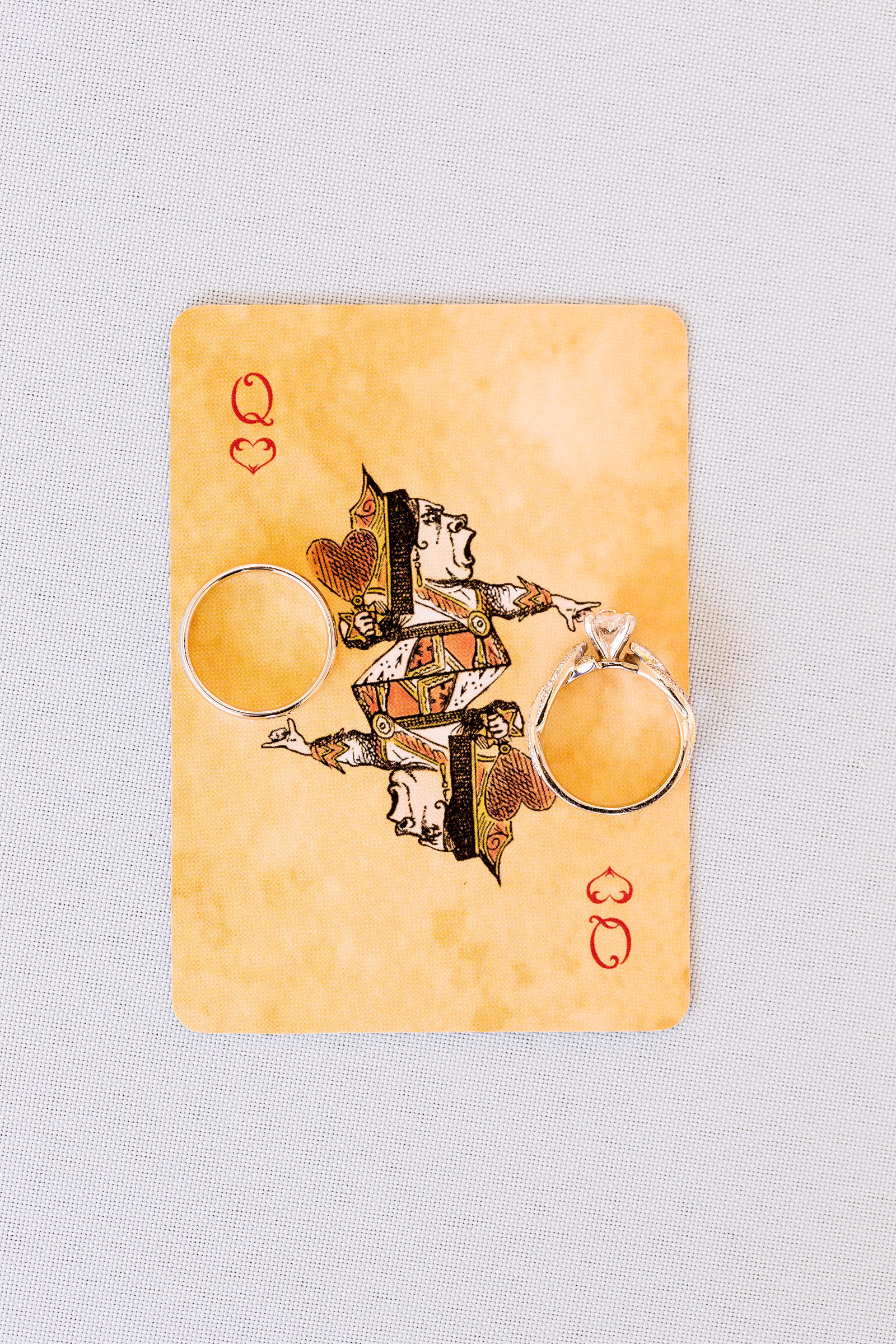rings-on-queen-of-hearts-playing-card-procopio-photography