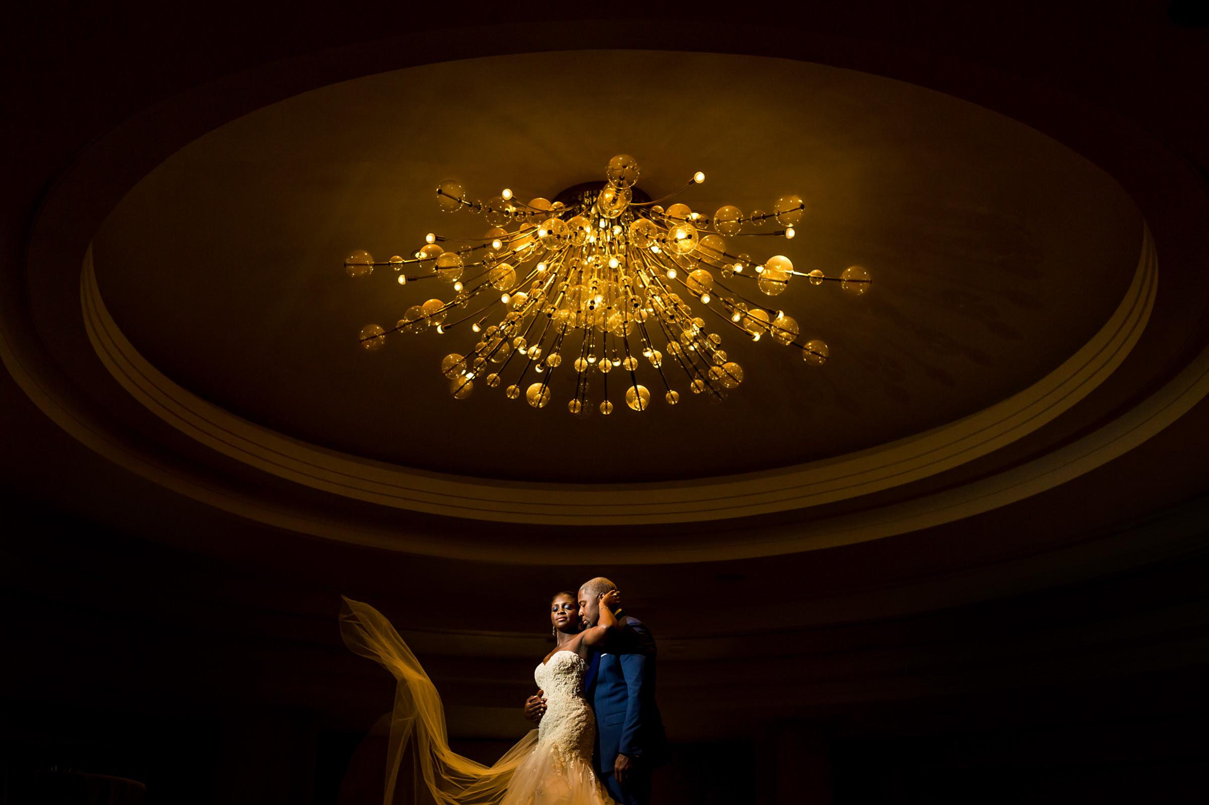 striking-couple-portrait-under-chandelier-procopio-photography