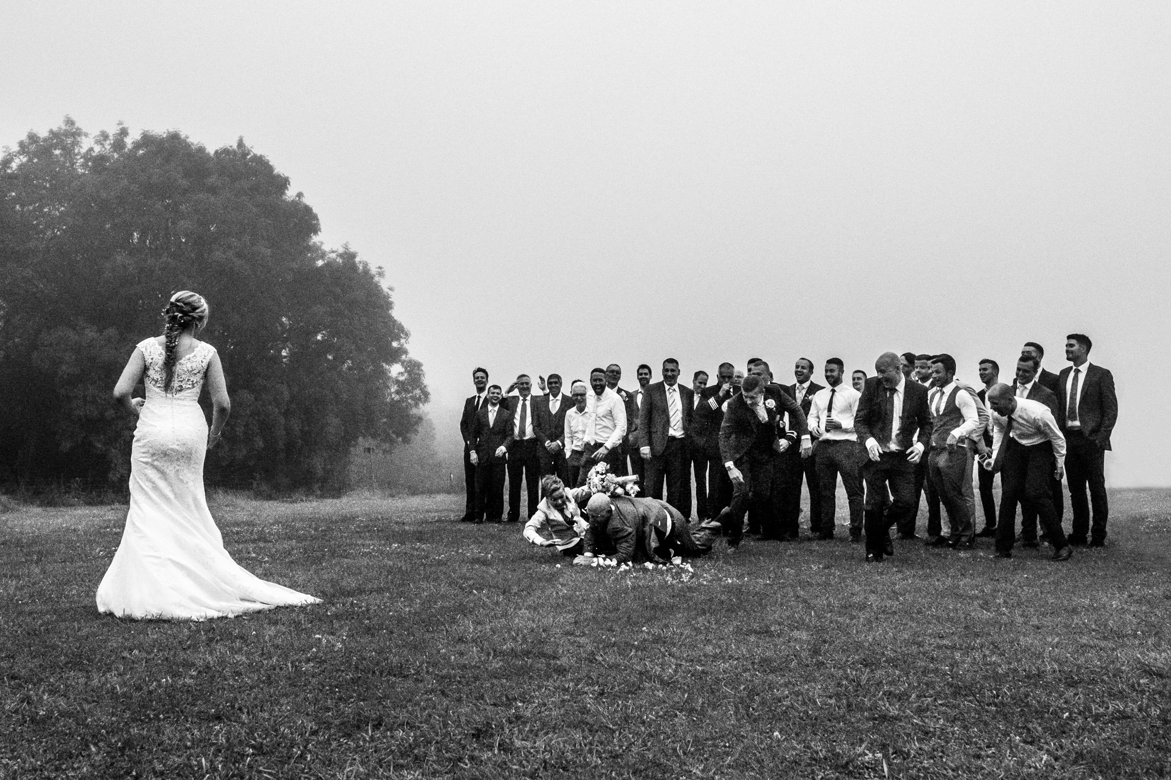 Guys go after bouquet and cause a mishap - M & G Wedding Photography - UK wedding photographers -