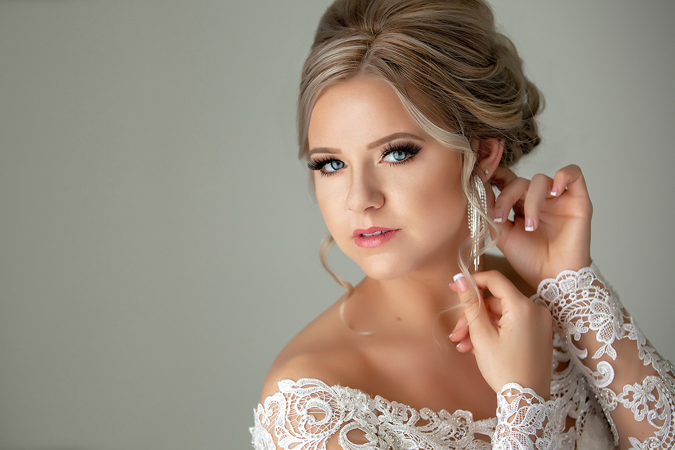 portrait-of-bride-with-blond-updo-silver-earrings-lace-gown-amber-henry-photography-michigan