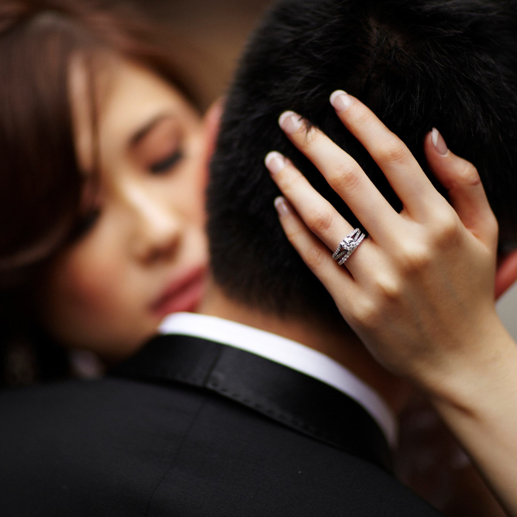 beautiful-asian-bride-wraps-her-left-hand-around-grooms-head-diamond-woven-rings-worlds-best-wedding-photos-jerry-ghionis-top-las-vegas-photographer
