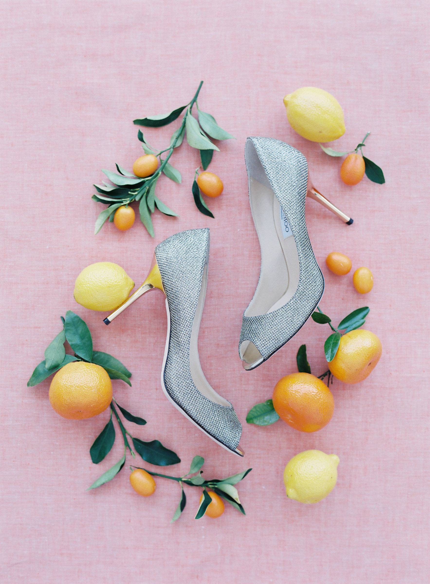 jimmy-choo-silver-pumps-surrounded-by-oranges-photographed-by-corbin-gurkin-worlds-best-wedding-photos