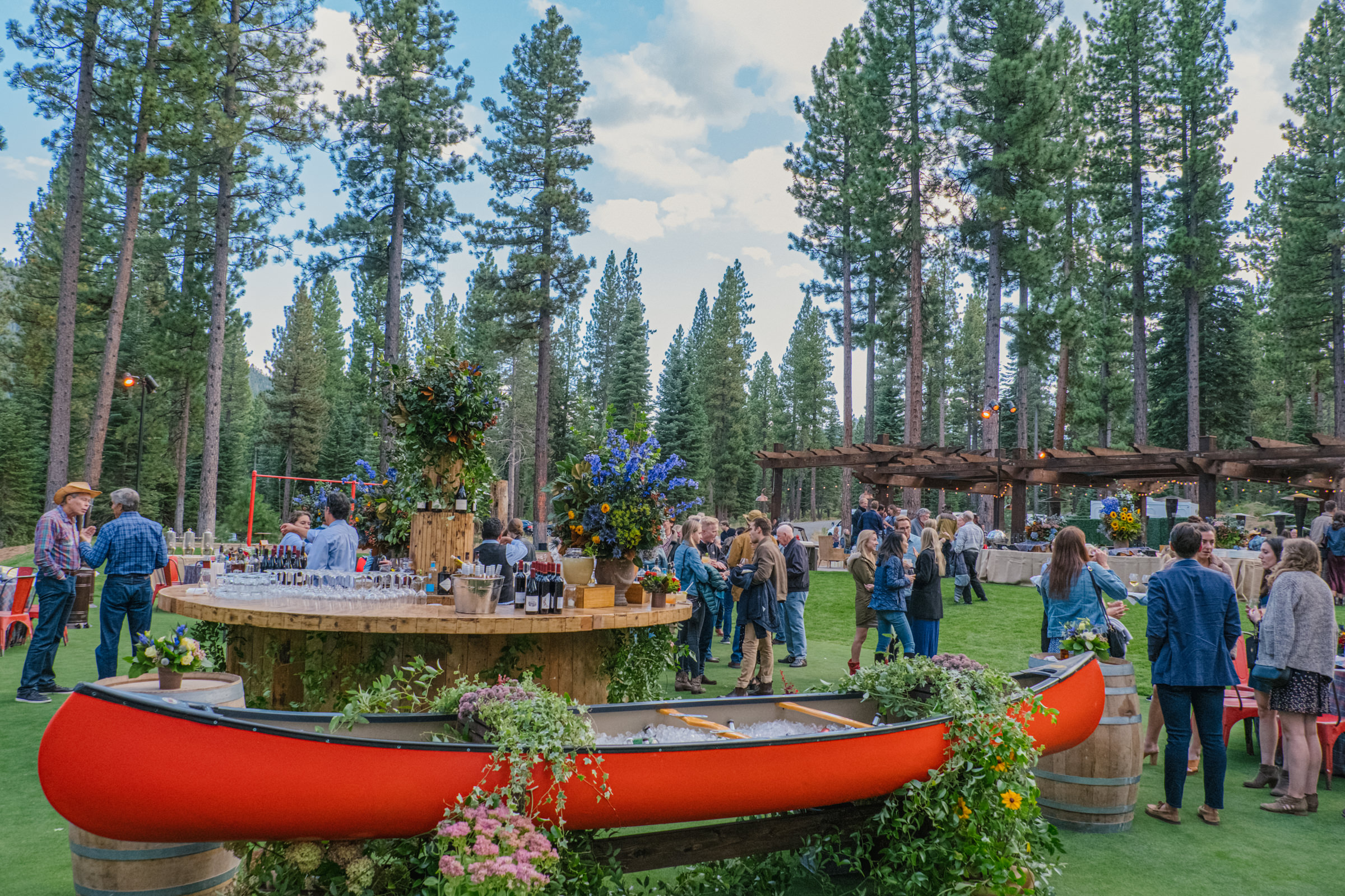 rustic-river-wedding-reception-with-red-canoe-amyandstuart-photography