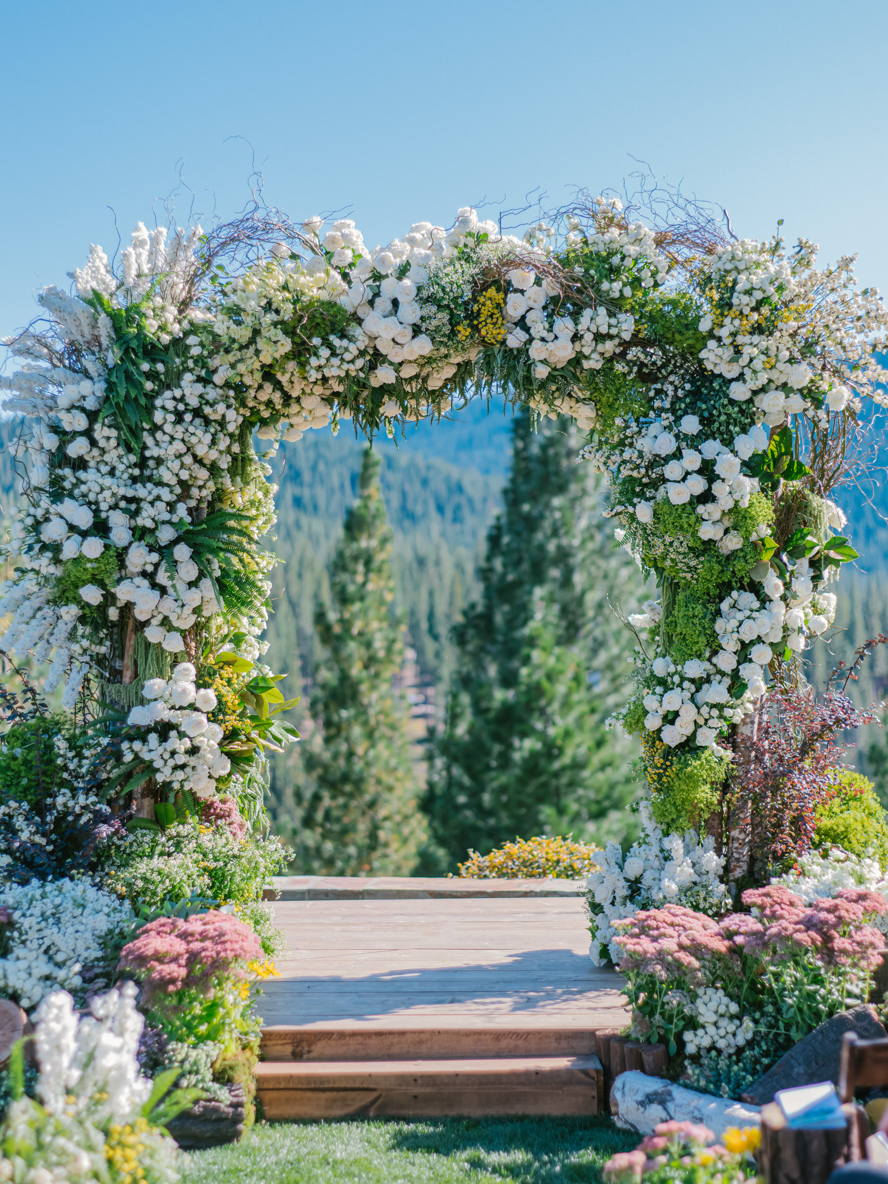 luxury-wedding-arbor-with-roses-and-vines-in-mountain-setting-amyandstuart-photography