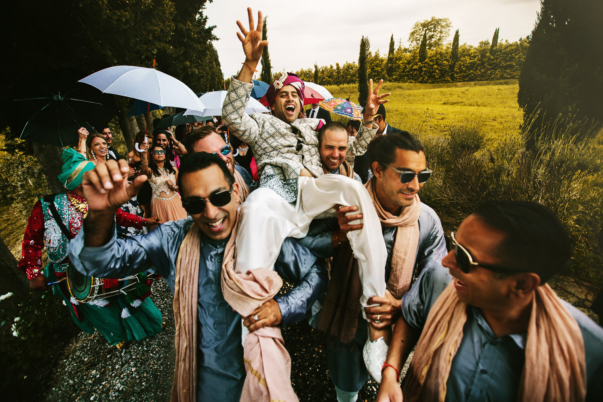 photo-of-groom-being-carried-by-groomsmen-during-indian-wedding-by-rino-cordella-in-puglia-italy