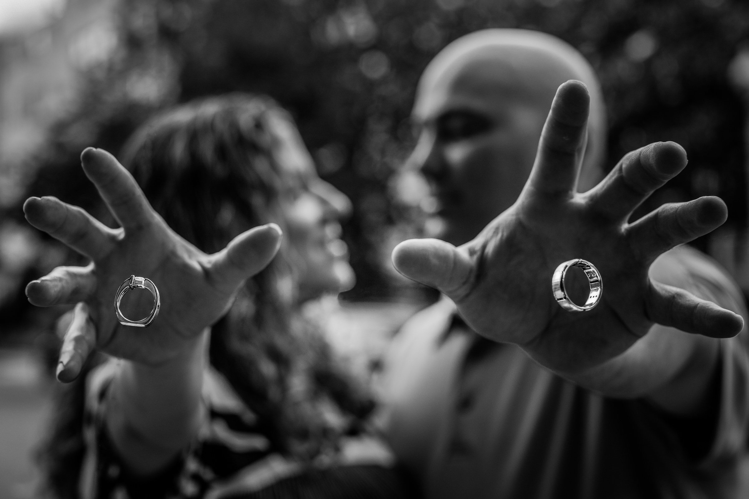 rings-in-motion-from-hands-of-groom-nat-wongsaroj-photography
