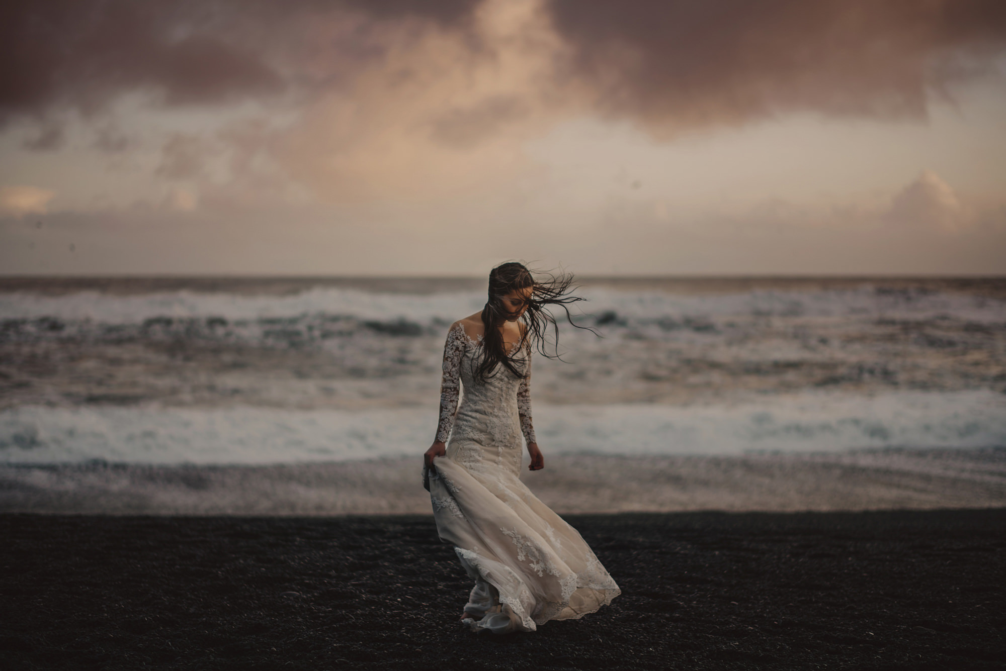 bride-walks-on-beach-with-long-sleeve-lace-trumpet-dress-worlds-best-wedding-photos-gabe-mcclintock-calgary-wedding-photographer