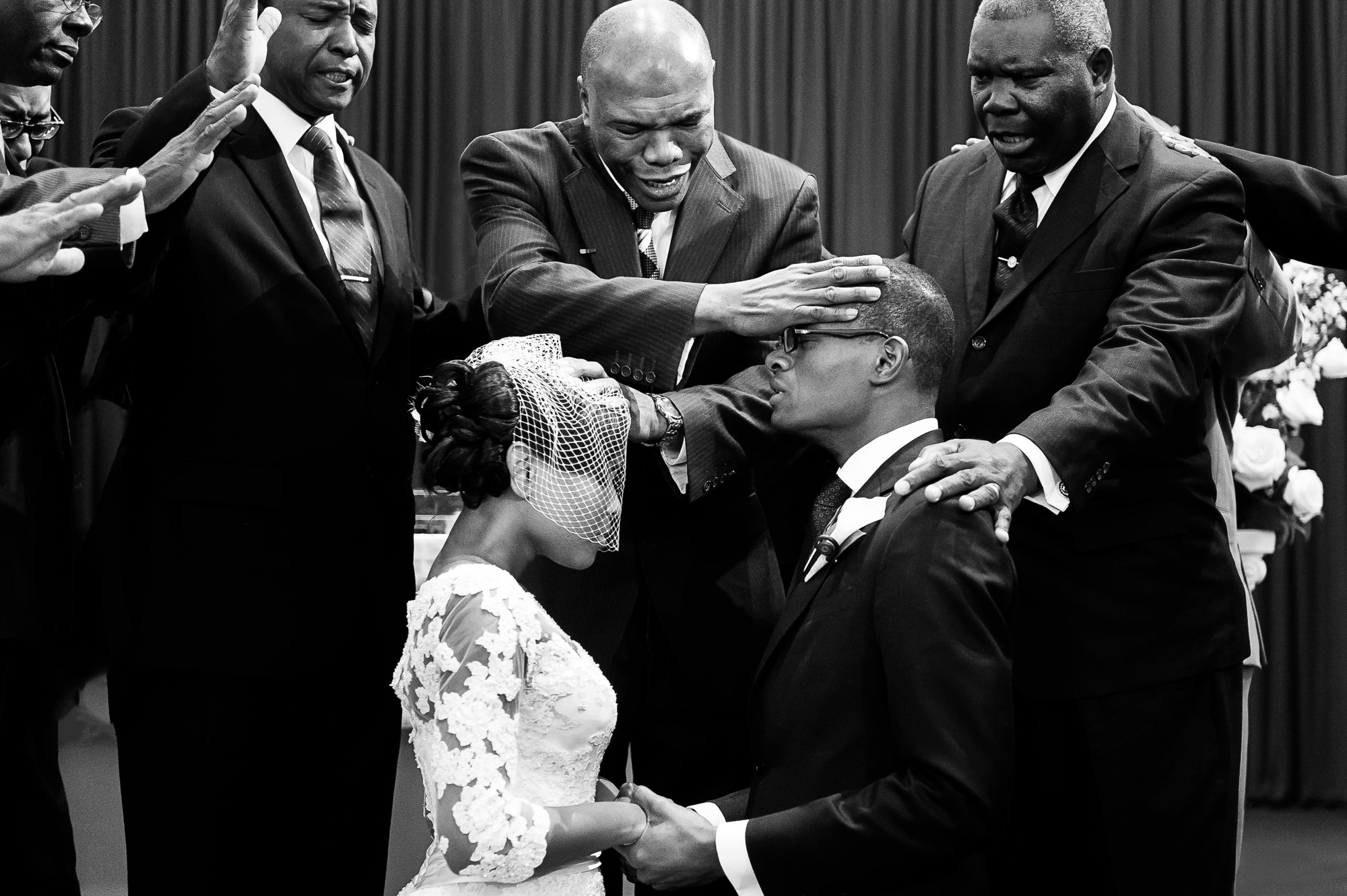 elders-bless-couple-on-their-knees-during-ceremony-at-u-of-maryland-chapel