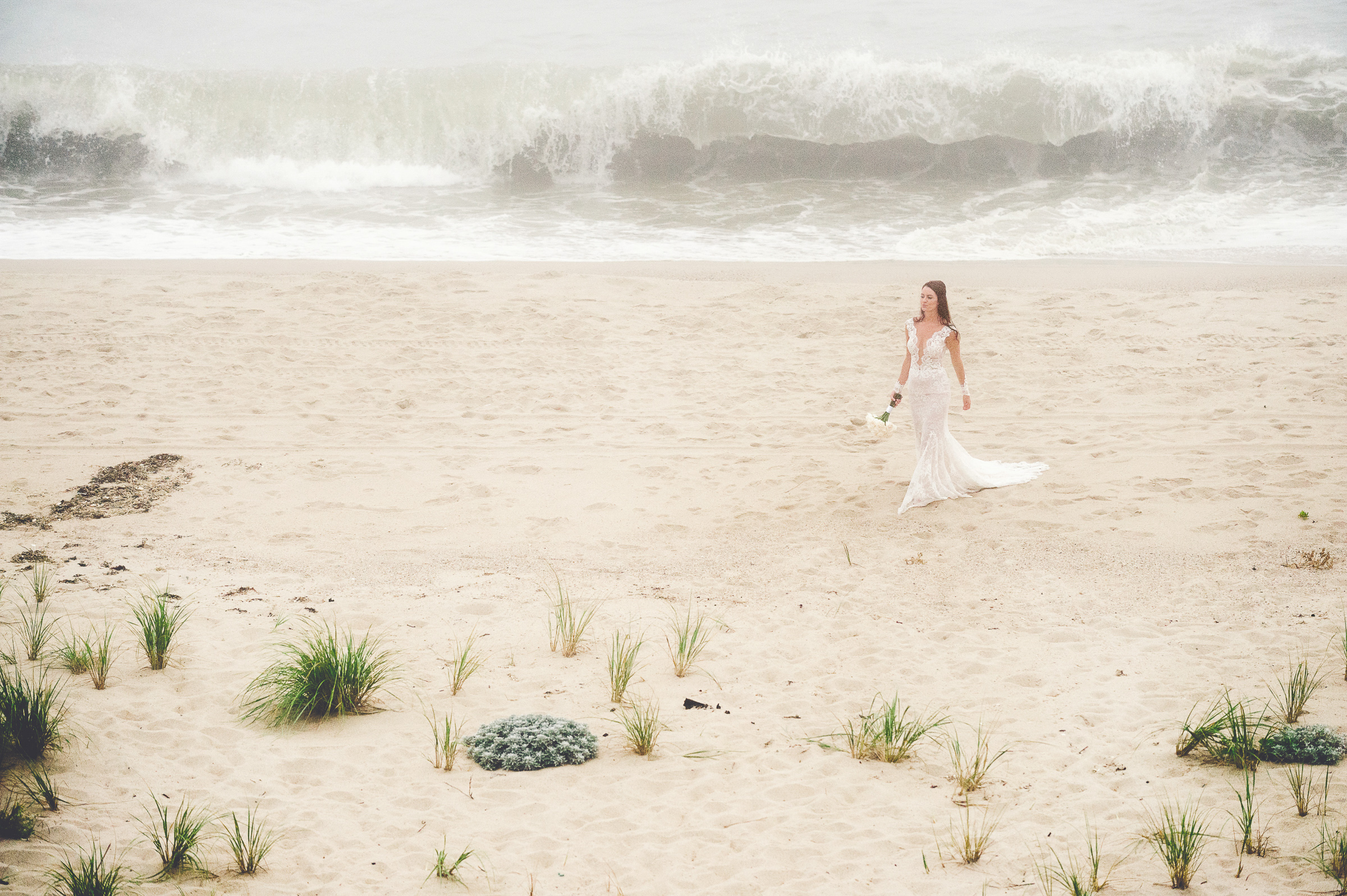 bride-on-beach-with-surf-zofia-co-photography