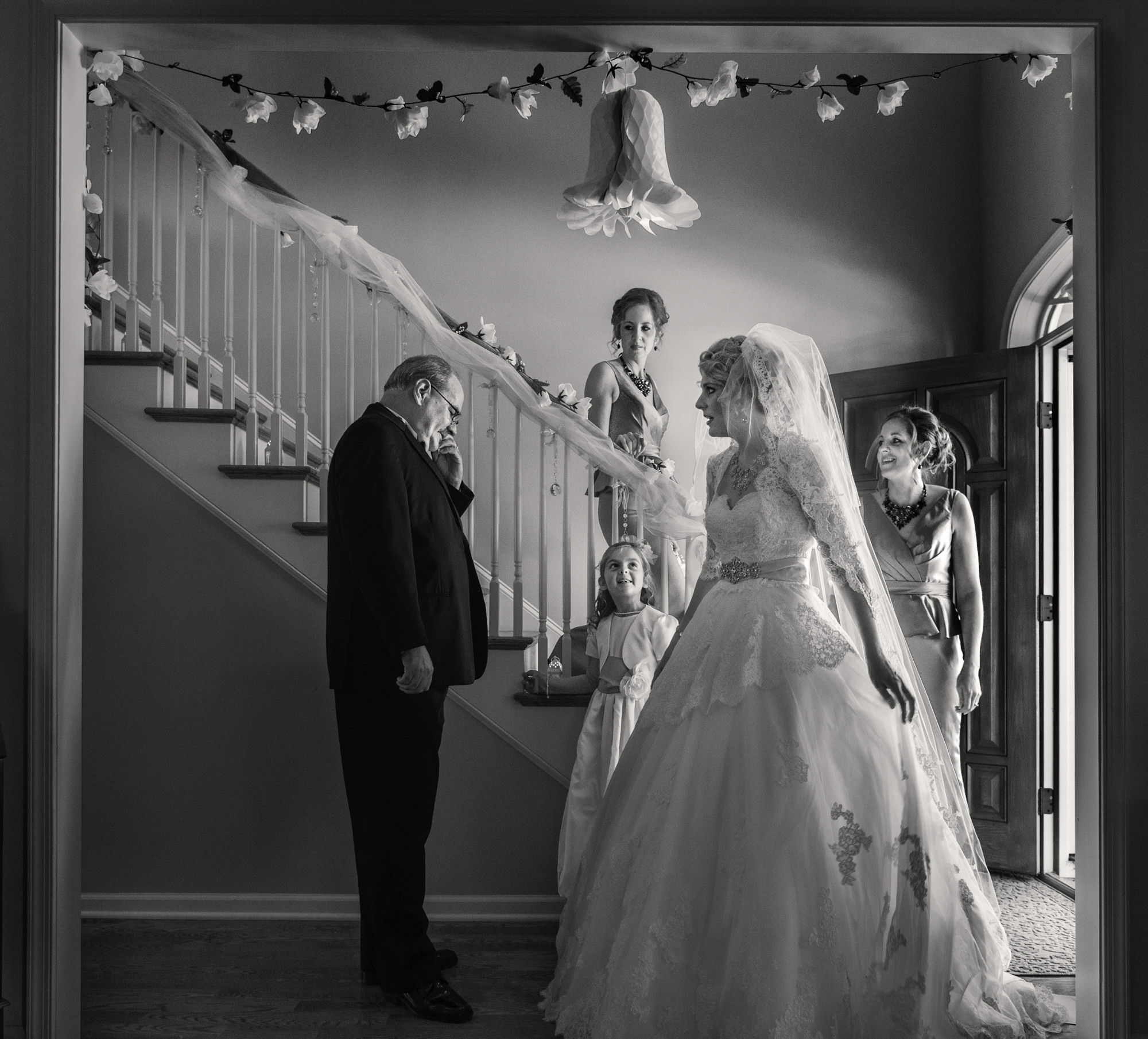 black-and-white-father-and-bride-first-look-with-family-on-stairs-worlds-best-wedding-photos-cliff-mautner-new-york-wedding-photographers