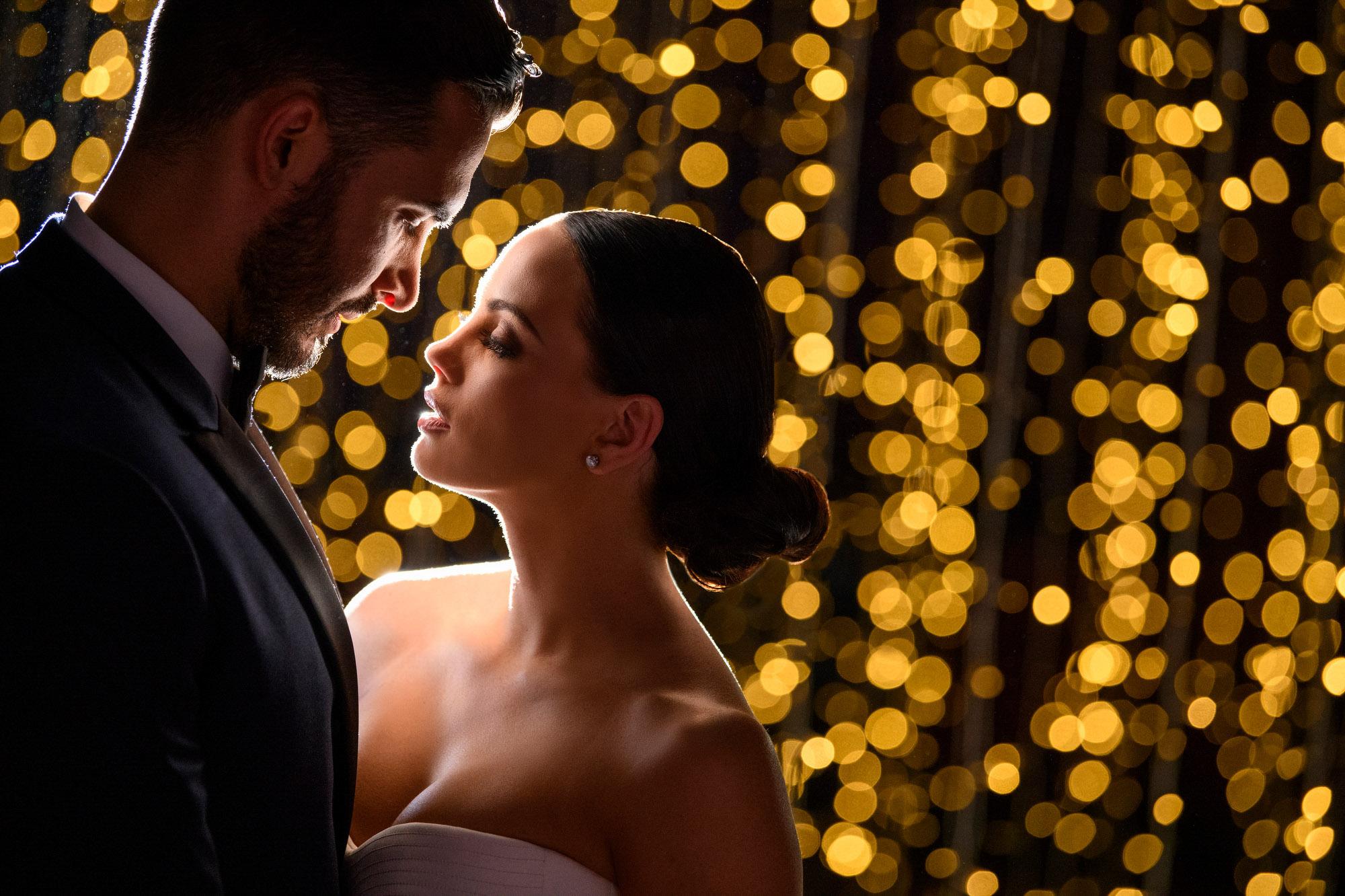 bokeh-portrait-brunette-bride-with-groom-best-wedding-photos-jerry-ghionis-top-las-vegas-photographer