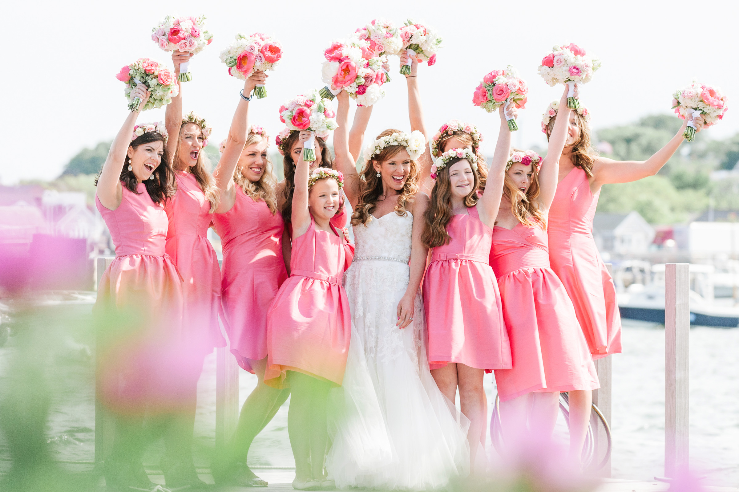 bouquets-in-the-air-for-bride-with-bridesmaids-and-flower-girls-zofia-co-photography