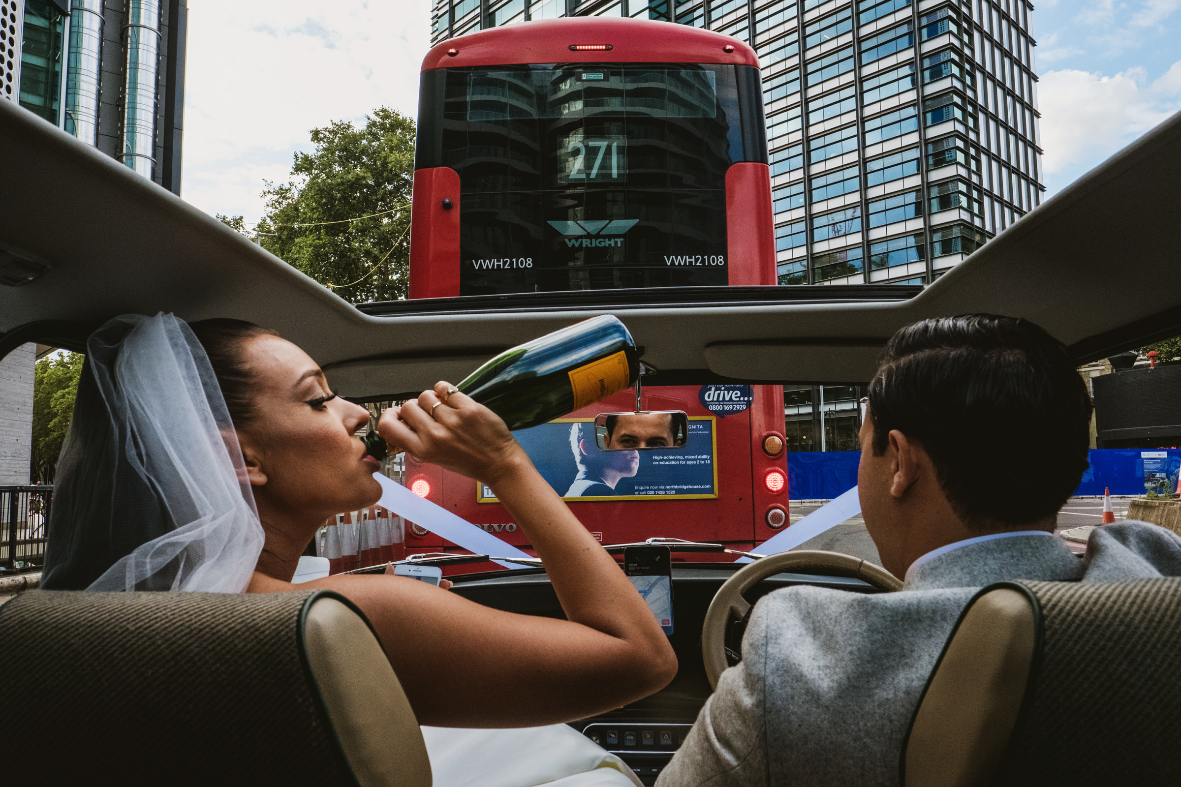bride-in-limo-taking-a-swig-york-place-studios