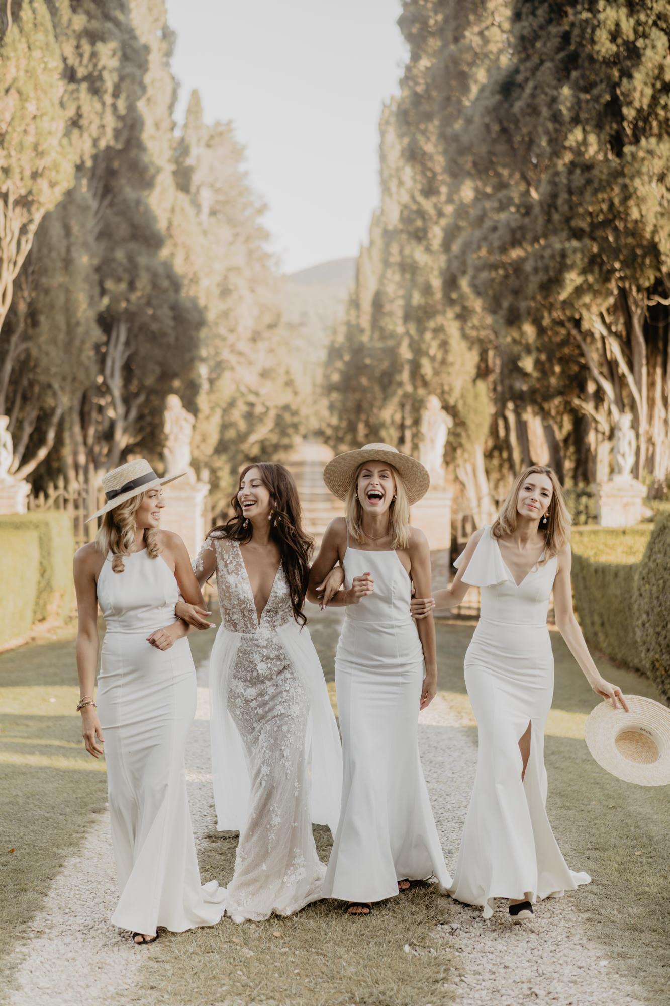 Bridesmaids wearing ivory spaghetti strap gowns - David Bastianoni - Italy