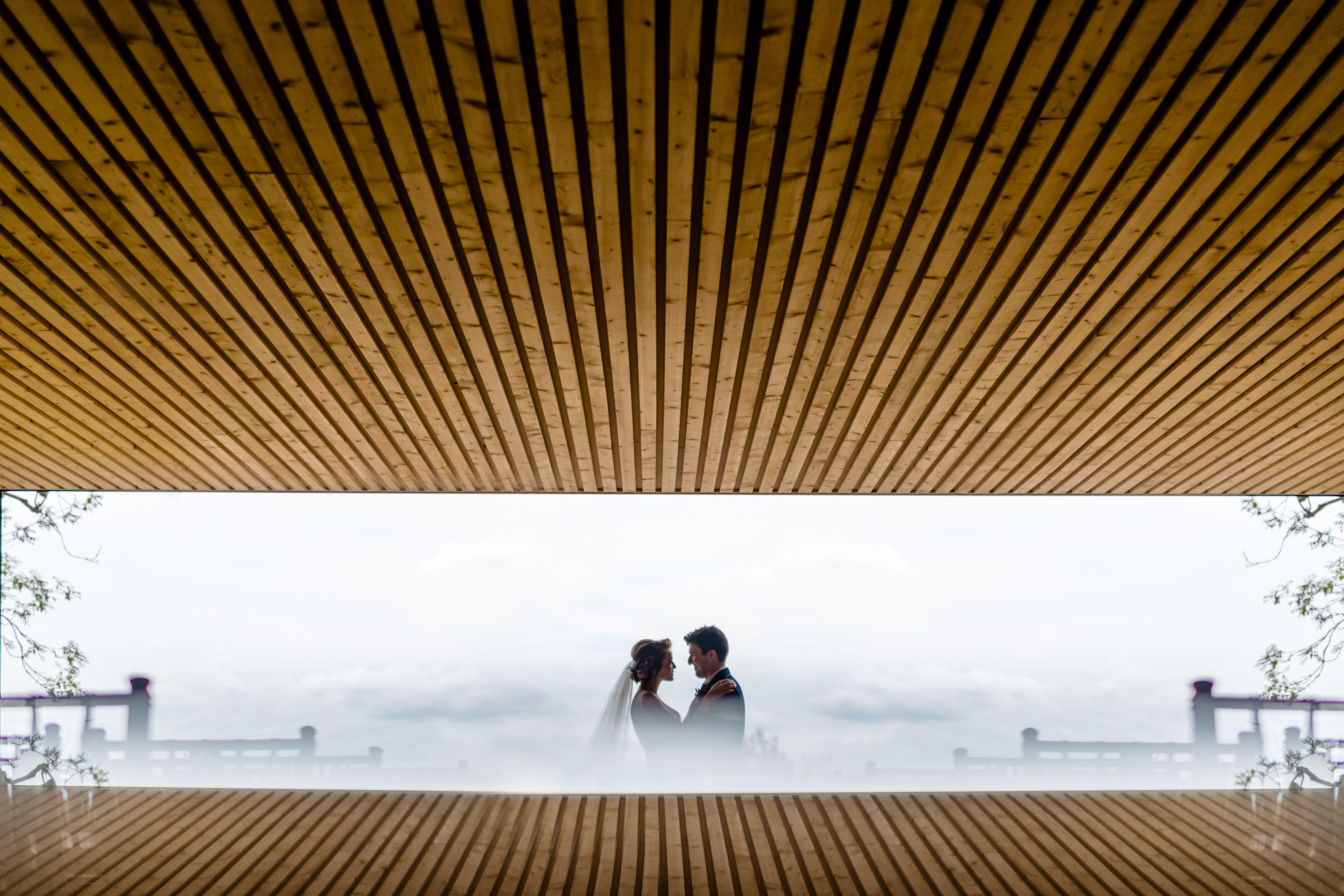 creative-composition-of-face-to-face-couple-in-the-mist-john-gillooley