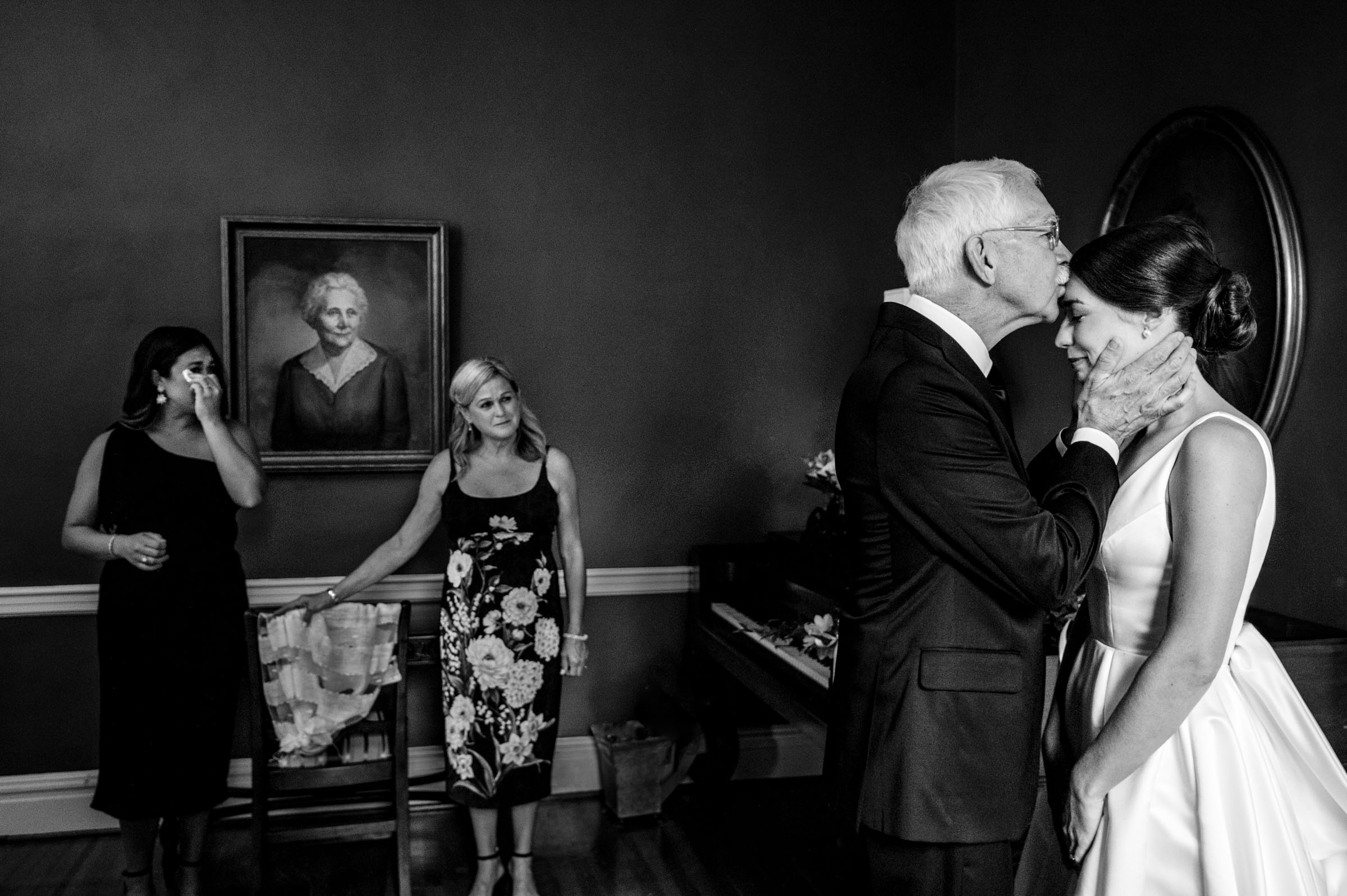 Father kisses bride before wedding by Marissa Joy Photography from Los Angeles
