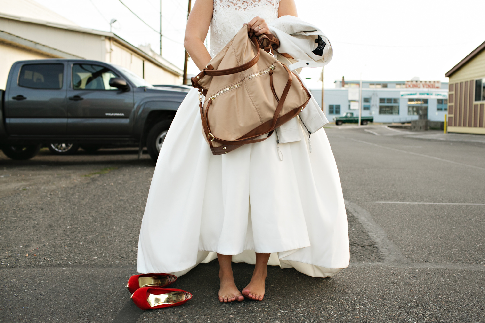 fun-bride-rummages-in-purse-and-take-her-red-shoes-off-worlds-best-wedding-photos-jenny-jimenez-seattle-wedding-photographers