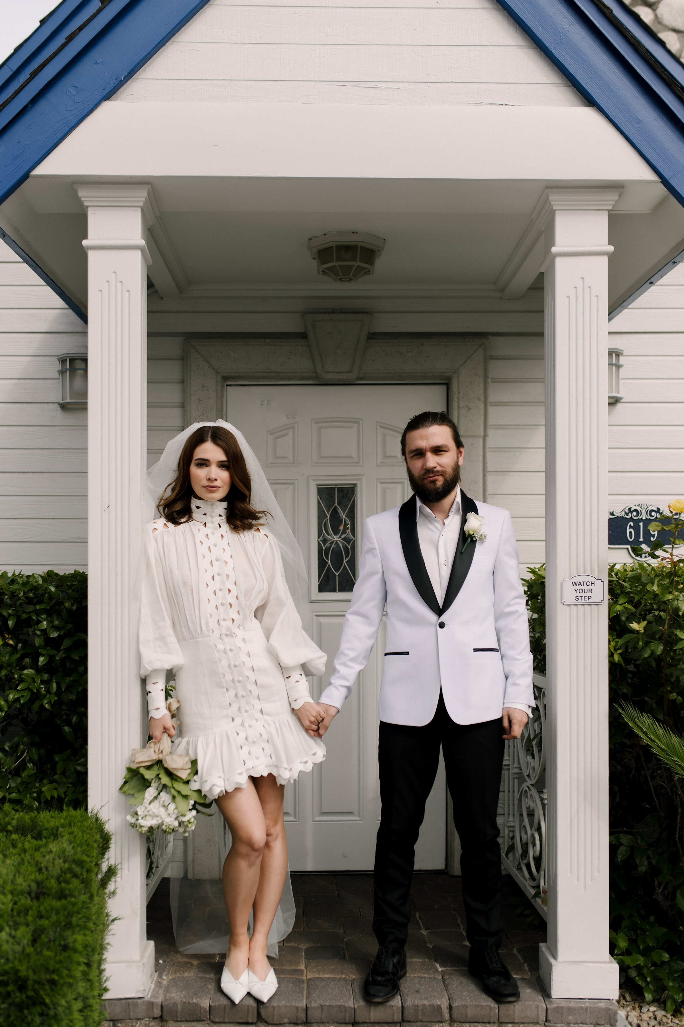 Stylish bride in short wedding dress and groom in Las Vegas wedding by Matei Horvath of Los Angeles