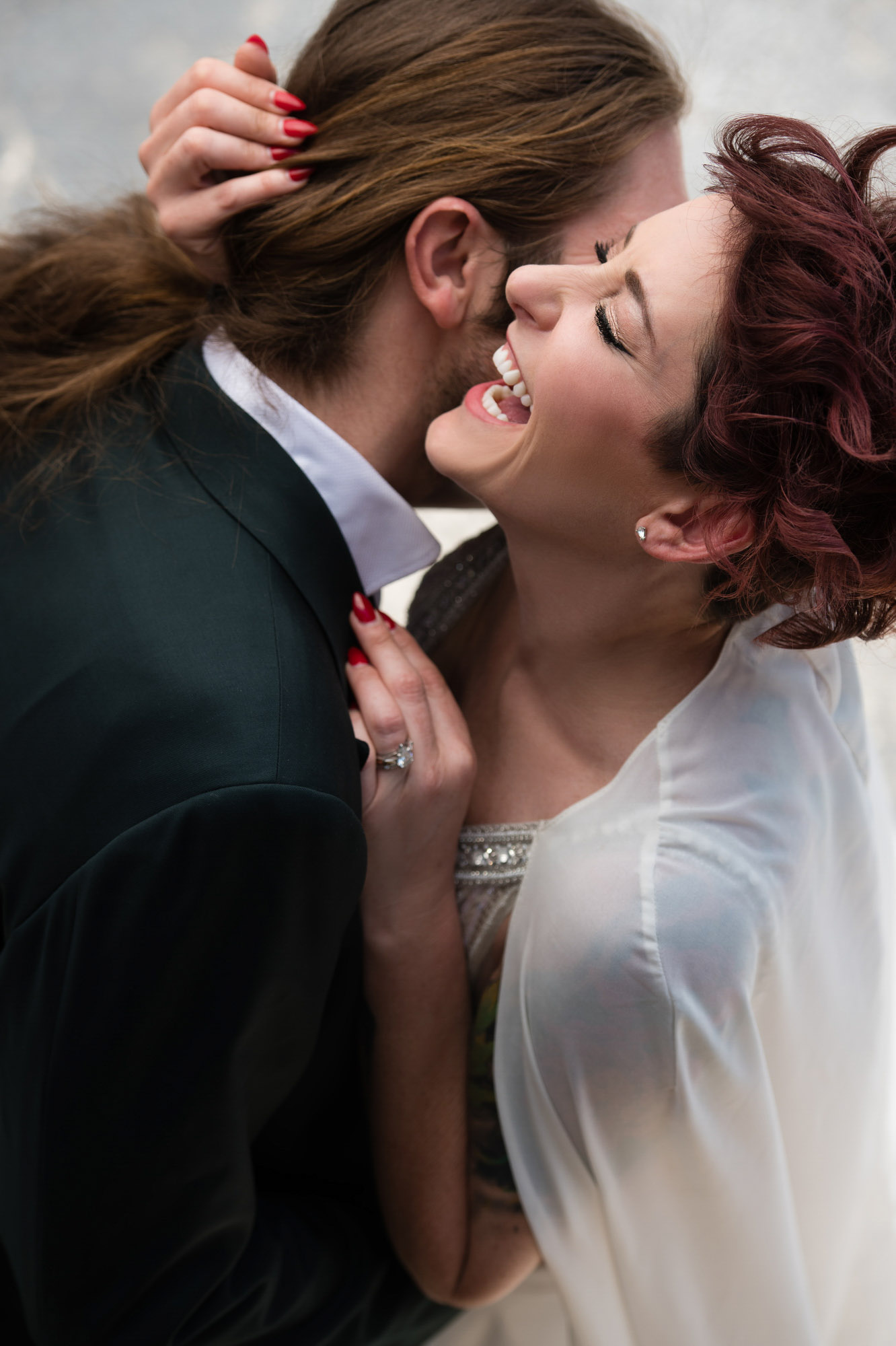 red-haired-bride-laughs-with-joy-while-embracing-groom-best-wedding-photos-jerry-ghionis-top-las-vegas-photographer