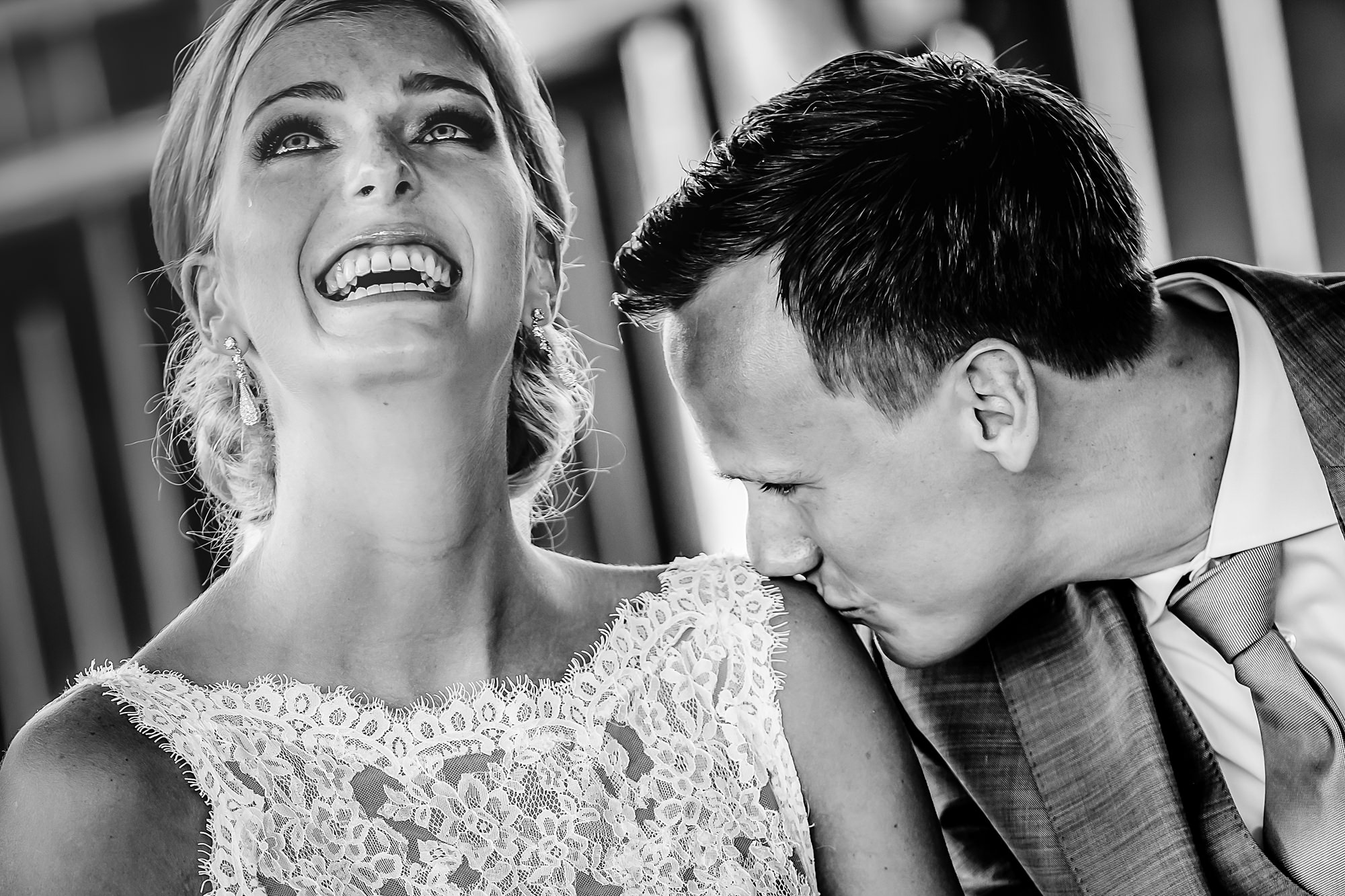 Touching bride tries not to cry as groom kisses her shoulder - photo by Eppel Photography