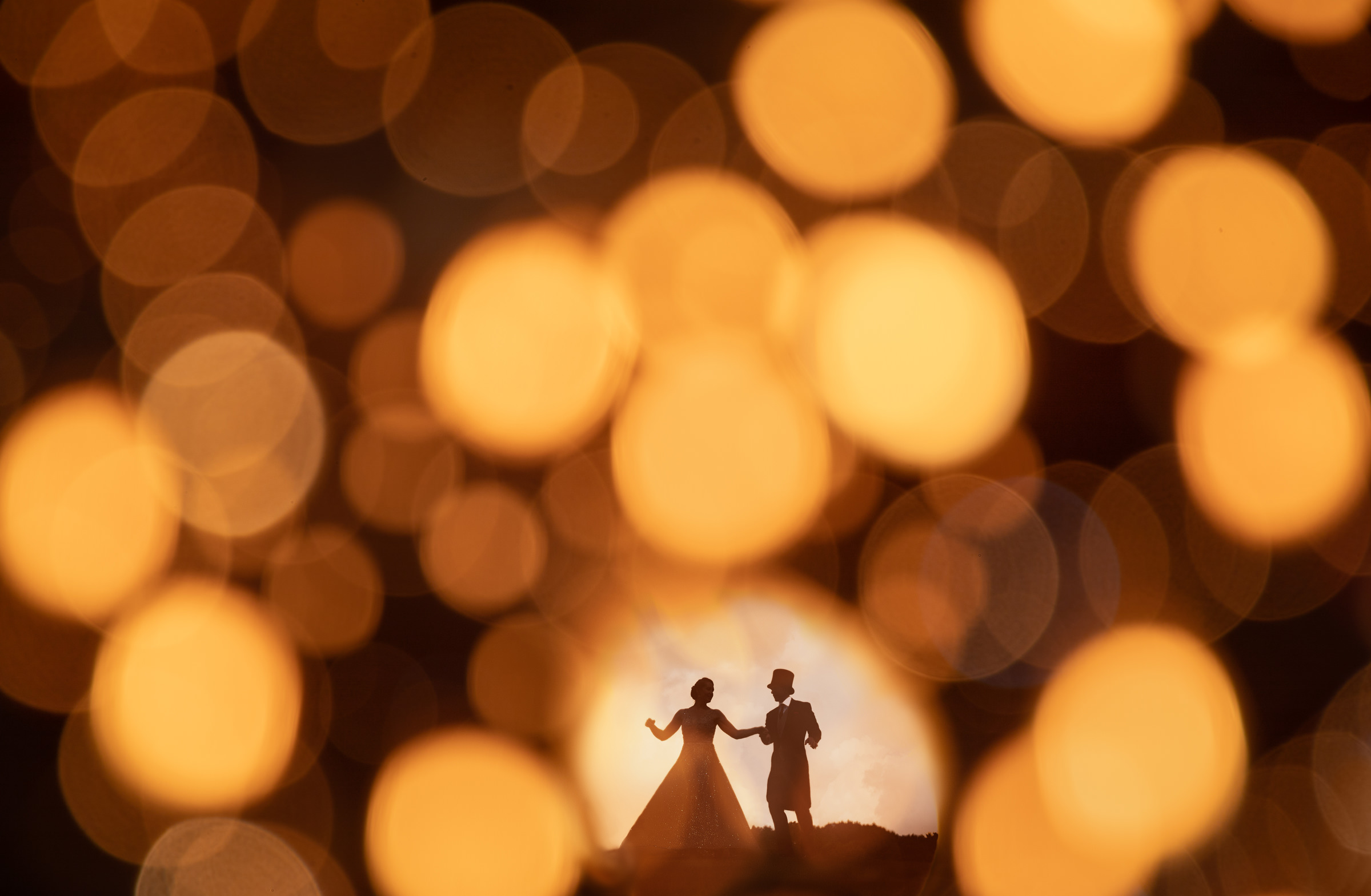 beautiful-silhouette-bride-and-groom-against-bokeh-double-exposure-by-susan-stripling-nyc-wedding-photographer