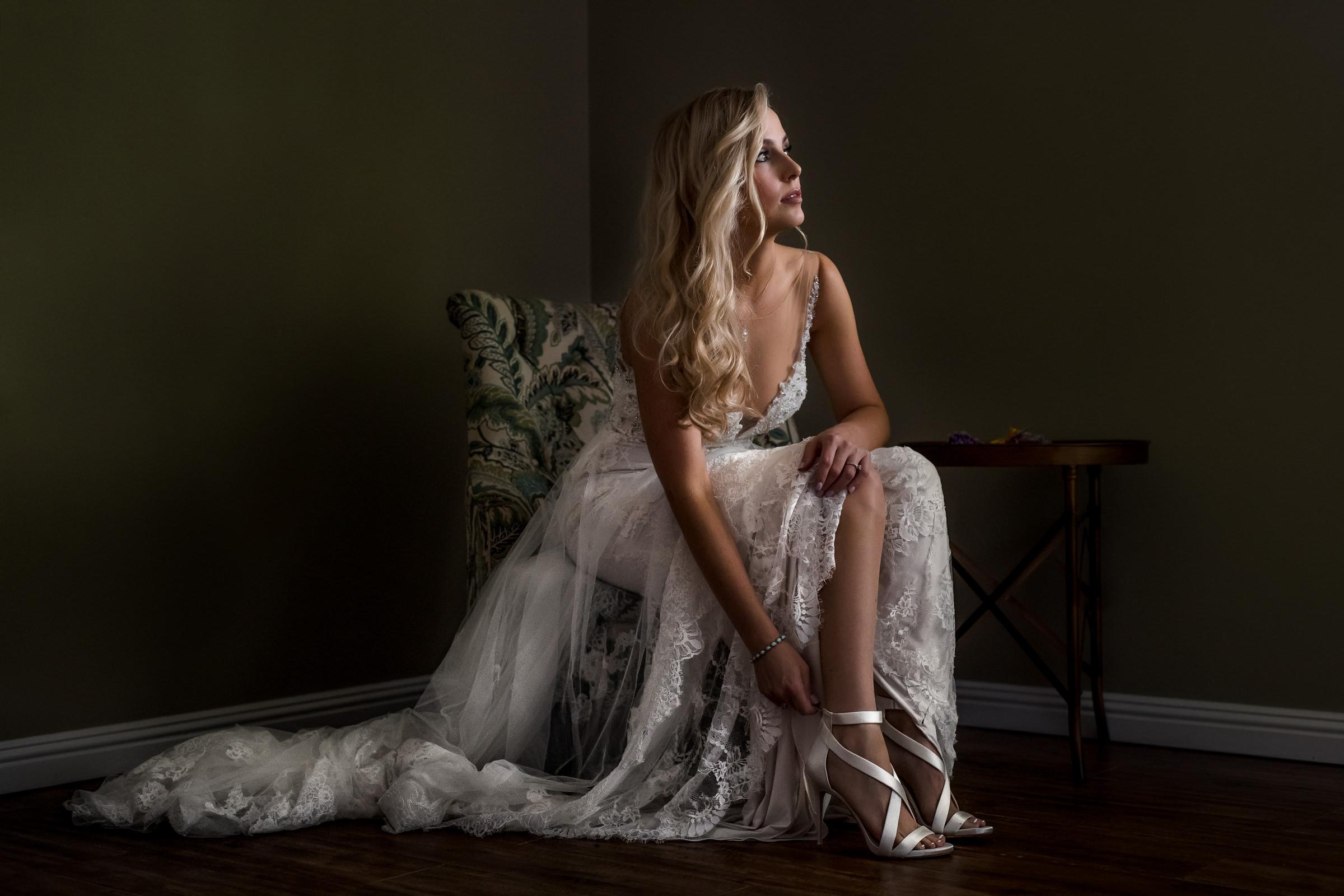 blond-bride-tying-up-her-satin-sandals-mhart-los-angeles-photographer