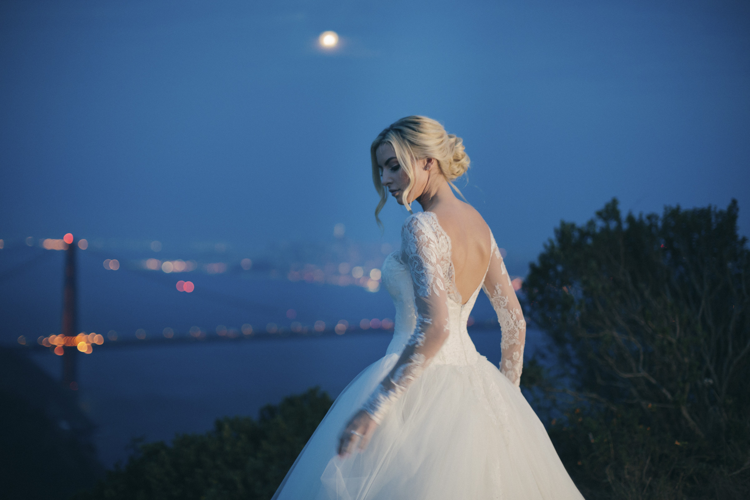 blonde-bride-with-updo-wearing-ballgown-with-lace-sleeves-amyandstuart-photography