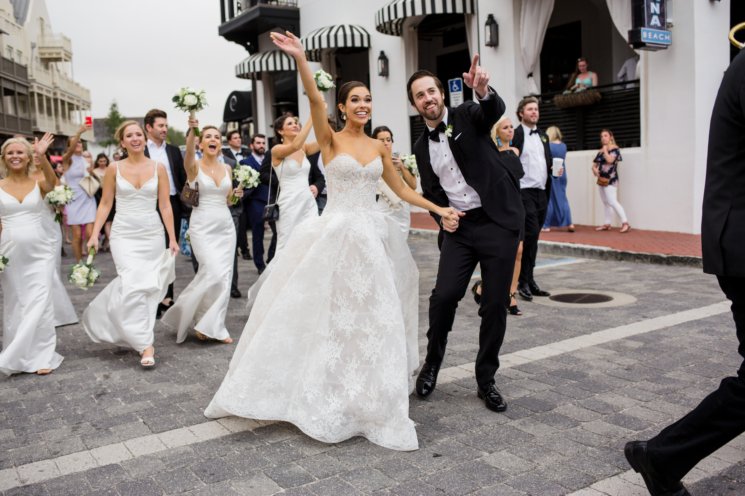 bride-groom-and-bridal-party-waving-to-guests-modernmade-weddings