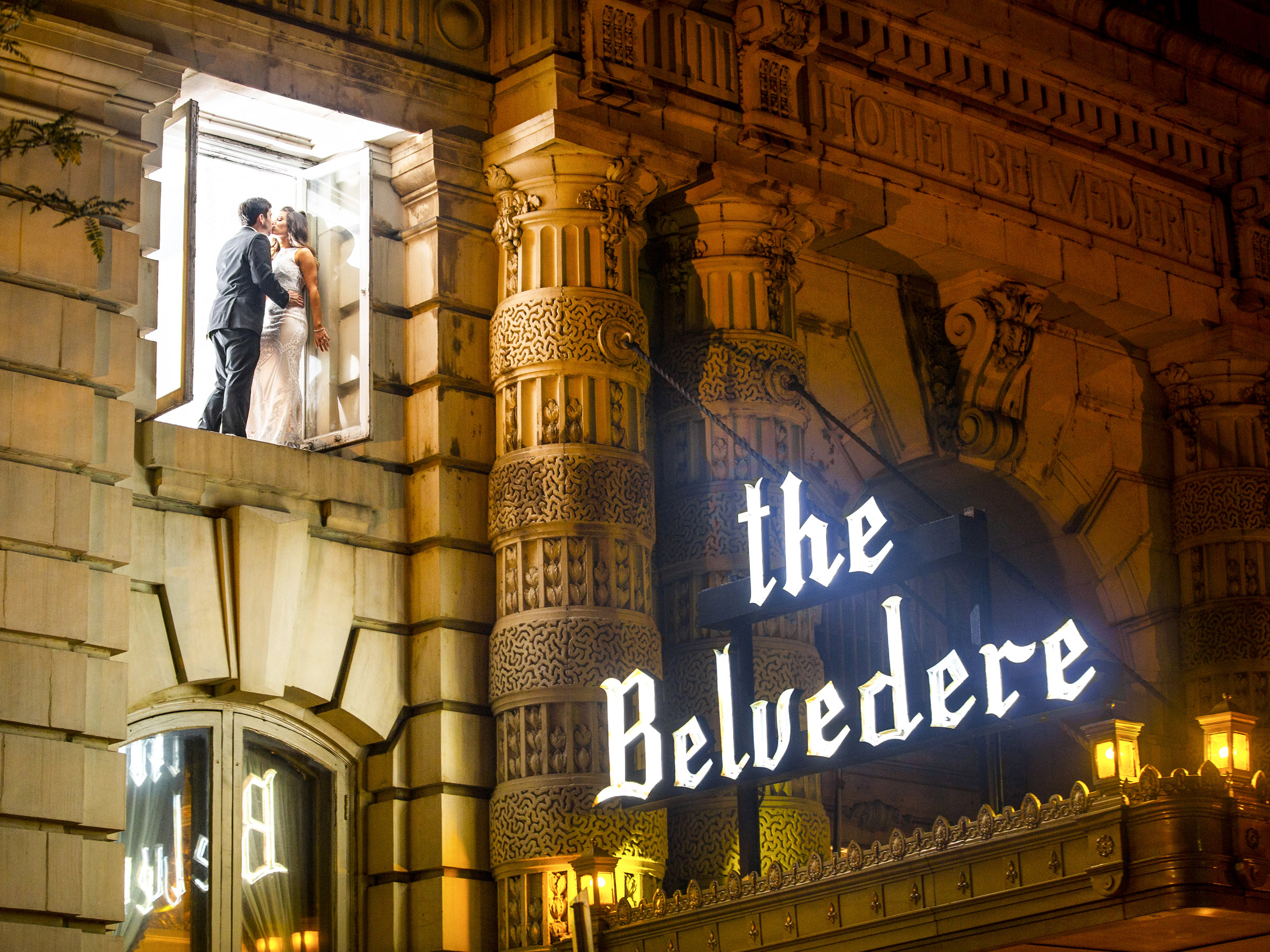 Couple at the window of the Belvedere Hotel - photo by Anna Scmidt - DC