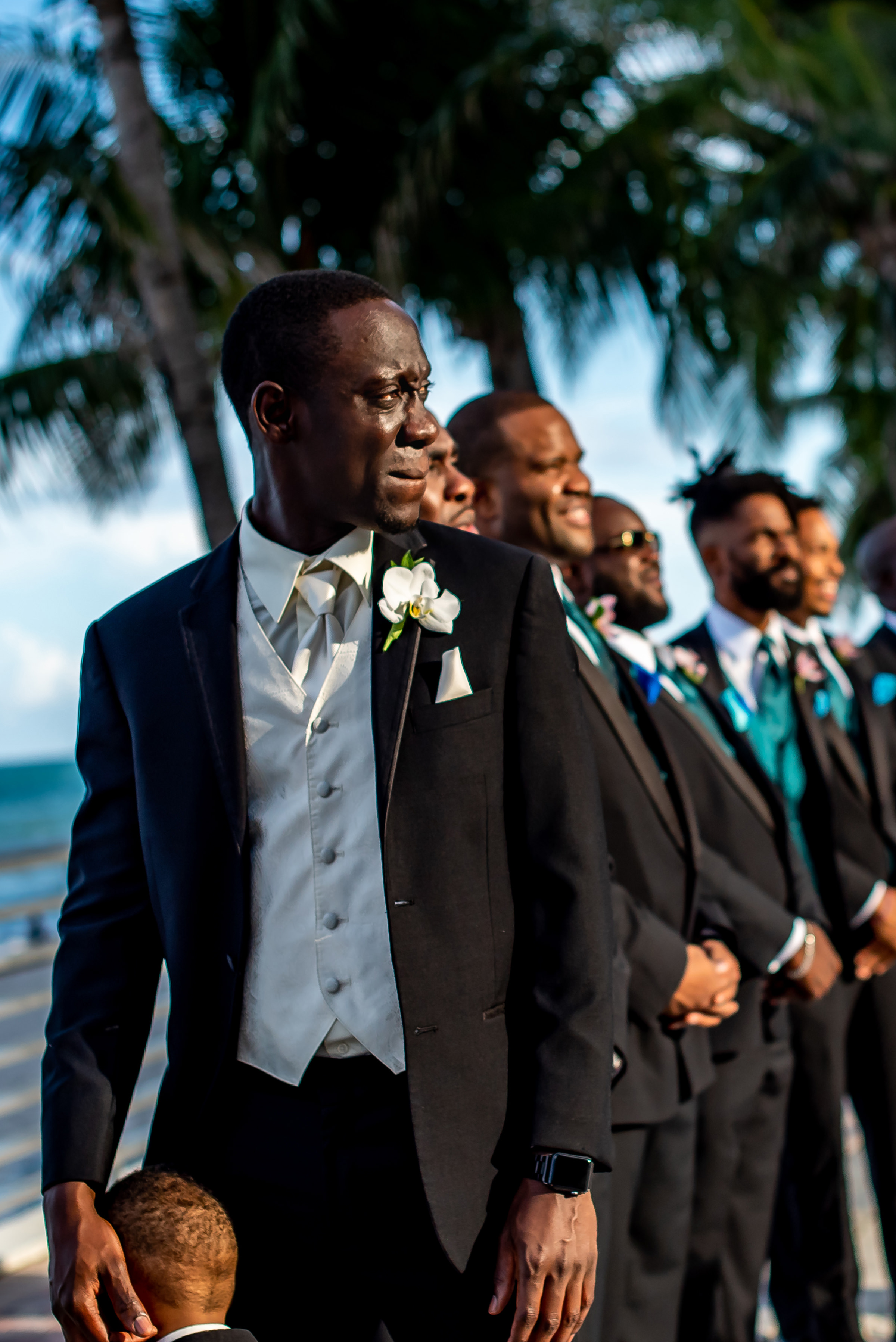 emotional-moment-for-groom-with-groomsmen-in-tropical-setting-gloria-ruth-photography