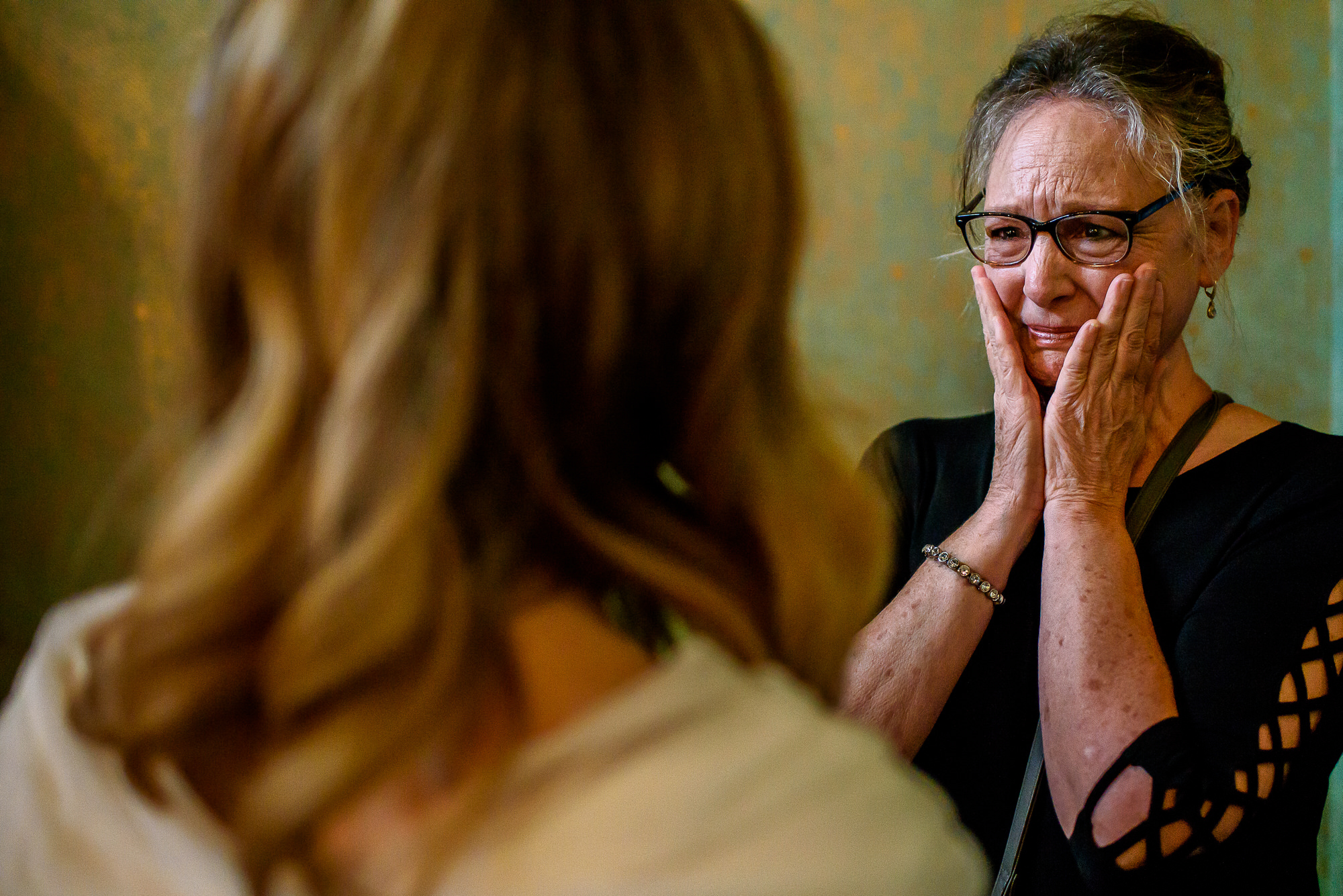 Mom breaks down crying seeing her daughter in wedding dress - photo by Tyler Wirken