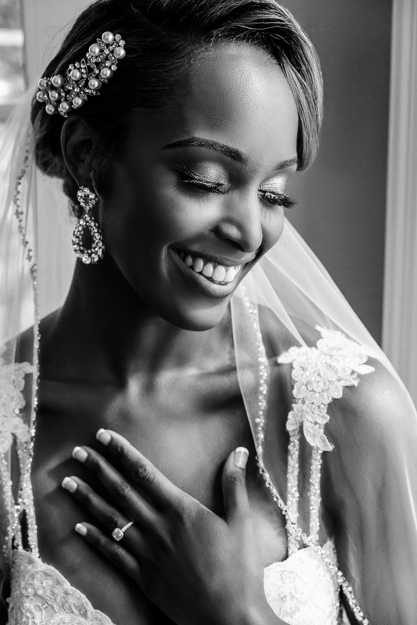 portrait-of-bride-wearing-beaded-veil-and-chandelier-earrings-christopher-jason-studios