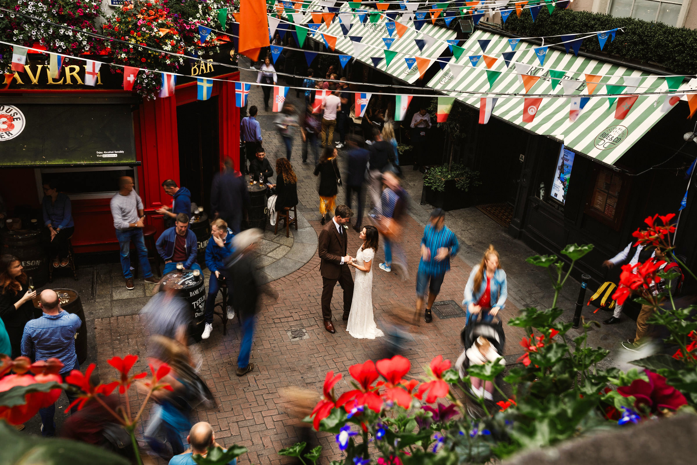 Dame-Lane-Dublin-aerial-view-of-couple-in-ireland-street-scene-with-colorful-bunting-lima-conlon-photography