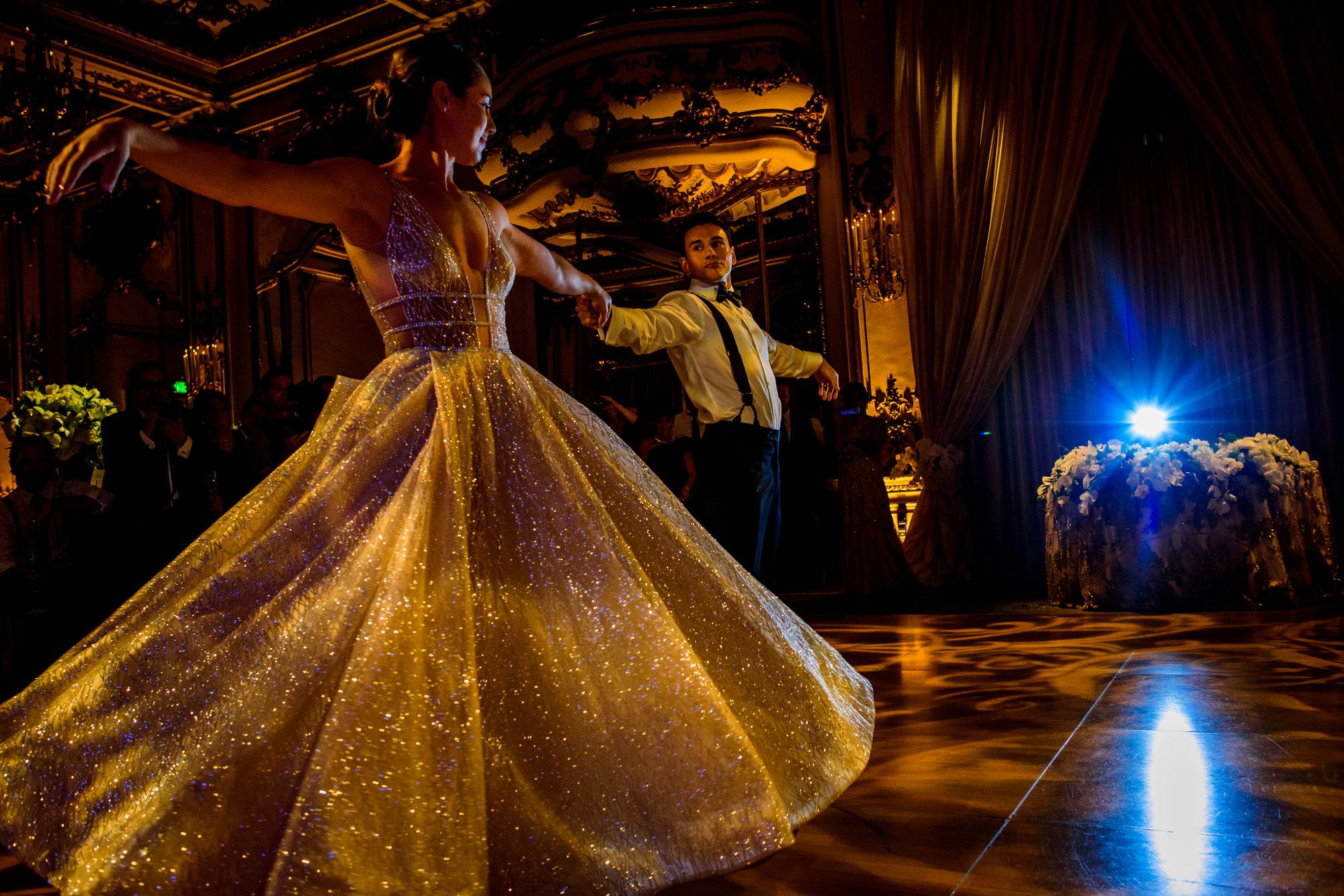 bride-and-groom-first-dance-golden-ballgown-worlds-best-wedding-photos-chrismans-south-carolina-wedding-photographers