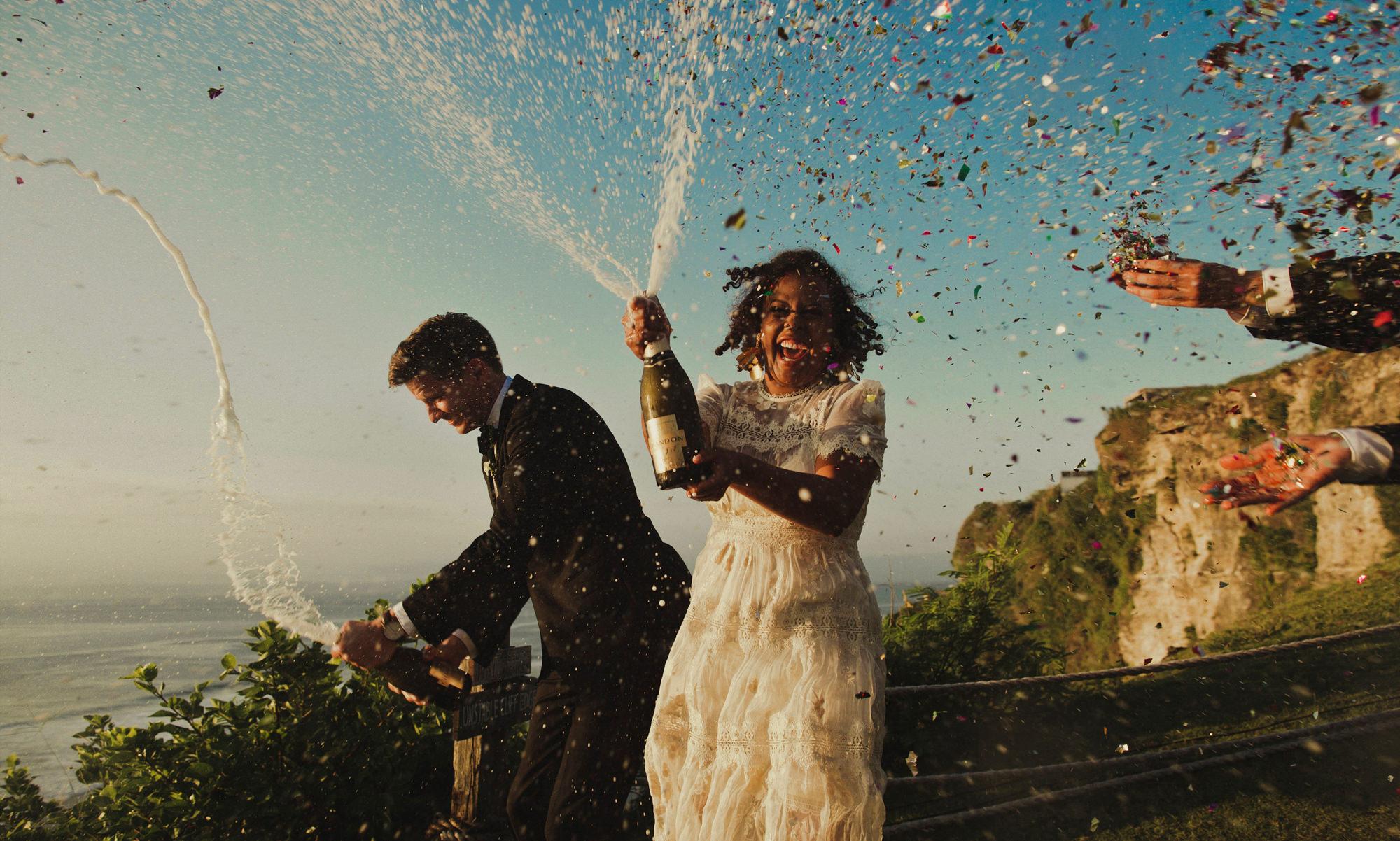 bride-and-groom-pop-champagne-with-confetti-worlds-best-wedding-photos-dan-o-day-australia-wedding-photographer